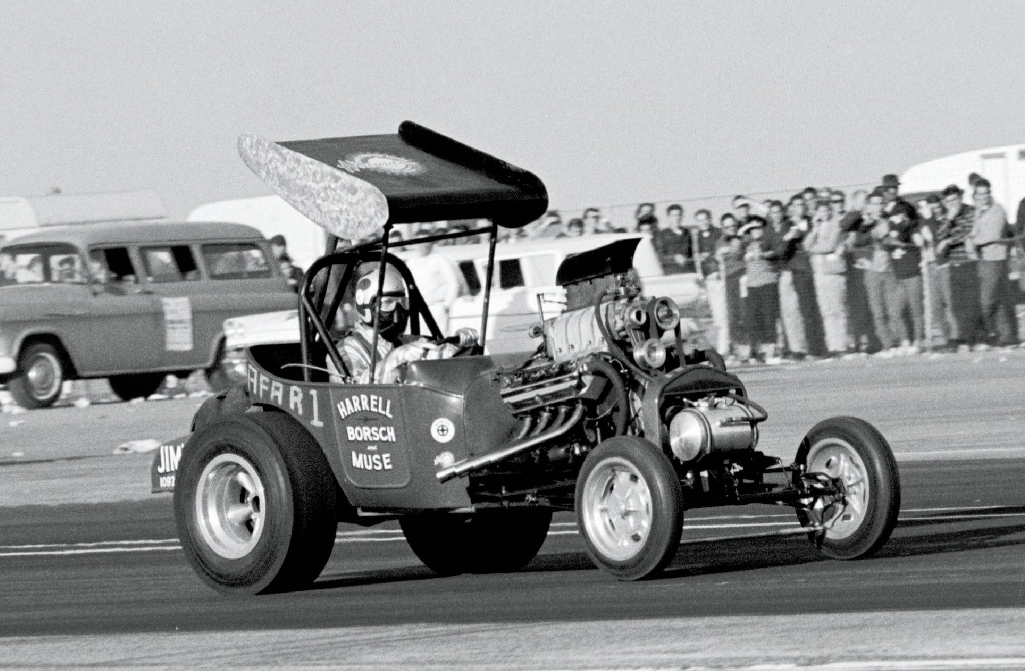"""During Bakersfield's sixth U.S. Fuel & Gas Championships, Harrell, Borsch & Muse experimented both with and without a new, spring-loaded airfoil, whose angle varied with the T's speed. """"Wild"""" Willie Borsch's early two-handed, no-smoke driving style earned the meet's A/Fuel Altered Roadster class trophy at 9.59/171.59."""