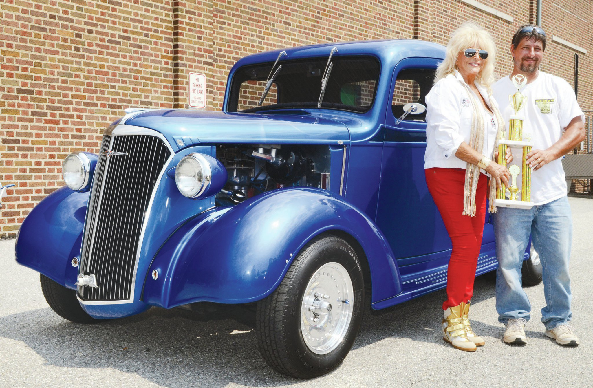 Part of Saturday's event is the Cruisin' Into Summer car show, which added another couple hundred vehicles to the invited entries already arranged indoors. After judging, Linda Vaughn was on hand to give awards to the winners.
