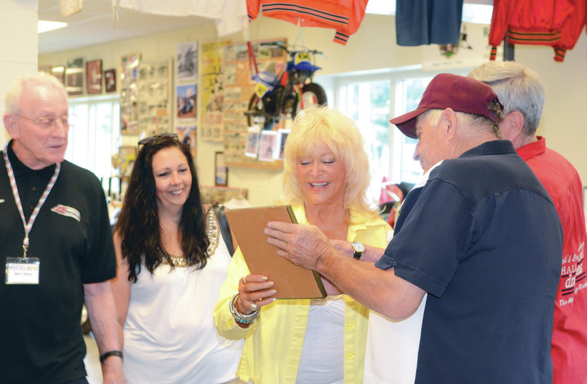 Linda Vaughn visited the EMMR during the Reunion. She's laughing at a recently uncovered photo of the late Tim Richmond pouring beer down her shirt. From left: A1 Transmission's Marv Ripes, Linda's assistant, Linda, Drag Times publisher Jack Redd, and tour guide and Sprint Car racer Lynn Paxton.
