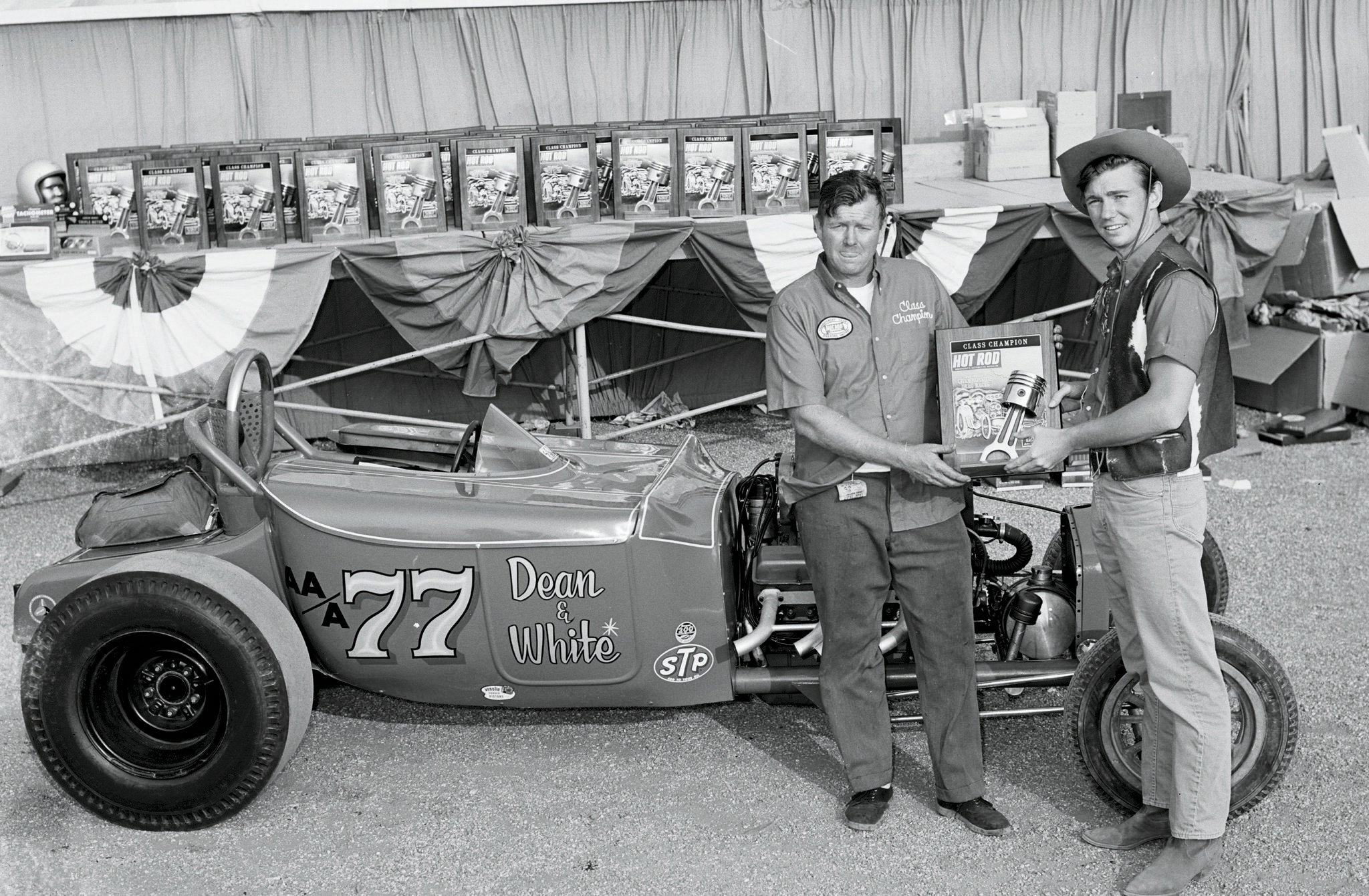 Nolan White, left, accepts his plaque for the class win at the '65 HRM Drags from Randy Boone, an actor in TV's The Virginian (which explains his goofy cowboy duds). That plaque, along with another White won at the HRM Drags in 1968, is still with the car.