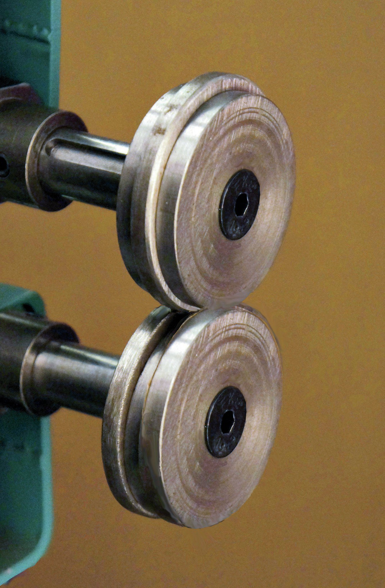 This is a set of simple, shop-made dies for a beading machine. They are made from flat washers, 21⁄2-inch OD, and 1⁄4-inch thick. You may have to drill out the center hole to match your particular beading machine.