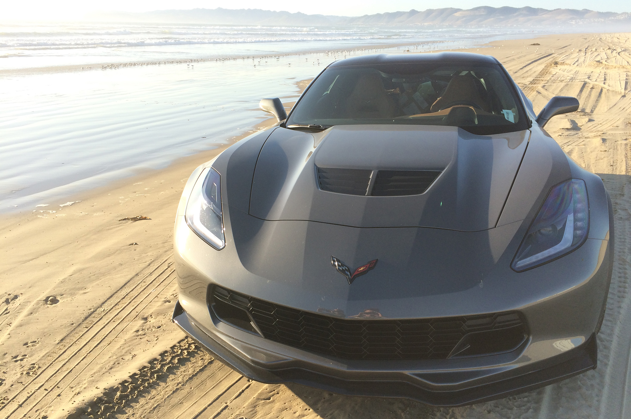 """Thanks to the 335mm wide rear Michelins and the LT4's supercharged power (does the """"L"""" stand for leviathan?), packed wet sand is no problem for a Z06."""