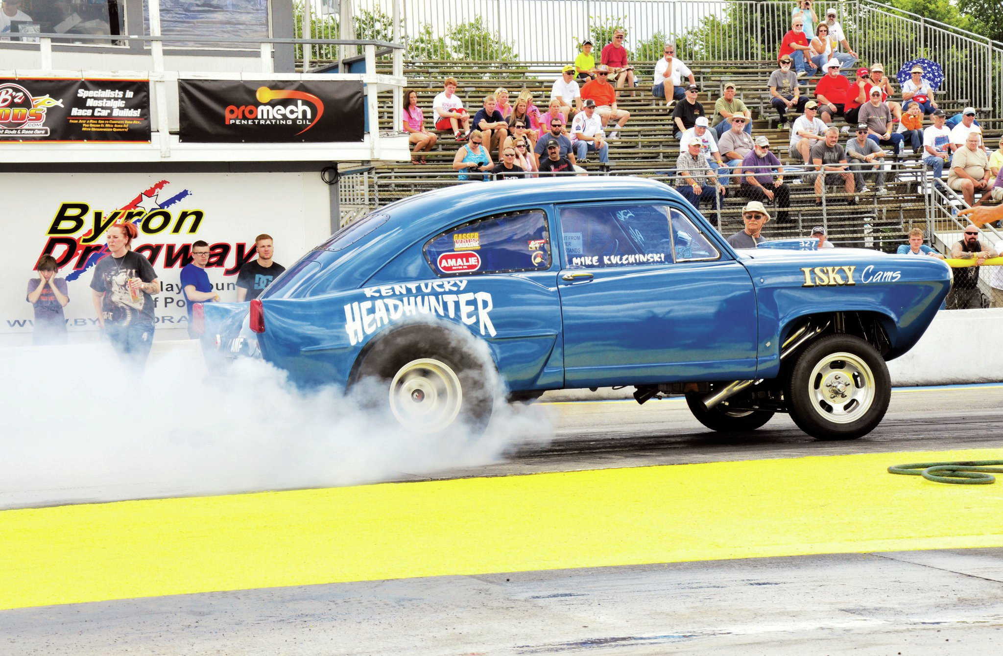 "The Kentucky Headhunter '51 Henry J gasser of Mike Kulchinski had no problem warming up the tires at Byron Dragway, the ""House of Hook."" Mike's blue Henry J is powered by a 327 small-block running an Isky cam. No doubt the Henry J's loyalty to Isky Cams made Meltdown Drags 2014 guest Ed Iskenderian very happy."