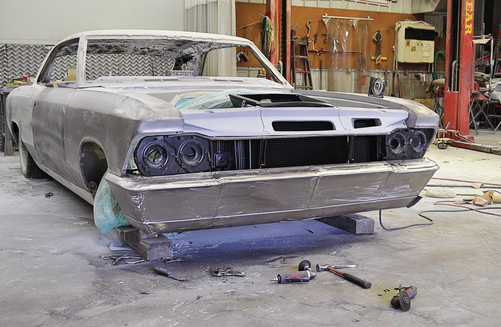 With the body and chassis reunited, the final fabrication and tweaks can be performed before the body is painted. Here the bumper is heavily reworked and an aluminum chin has been fabbed.