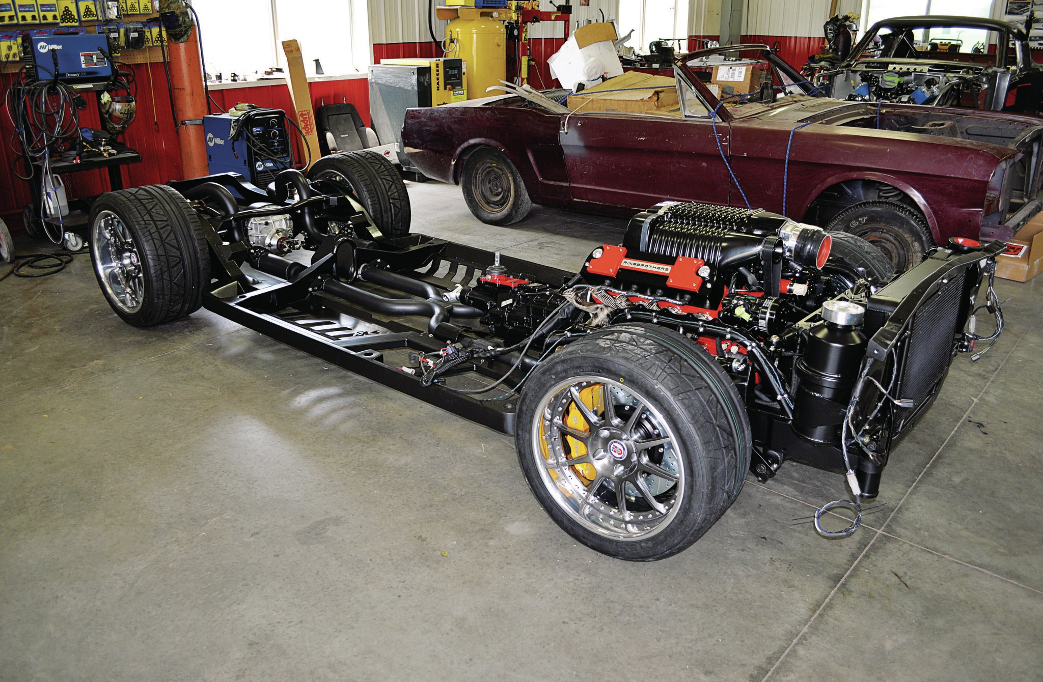 While the body has been undergoing extensive panel fitment and general bodywork, the chassis has been painted, assembled, and detailed. The Roadster Shop chassis features 2005–2013 Corvette C6 front suspension components, AFCO coilovers, and Baer brakes.