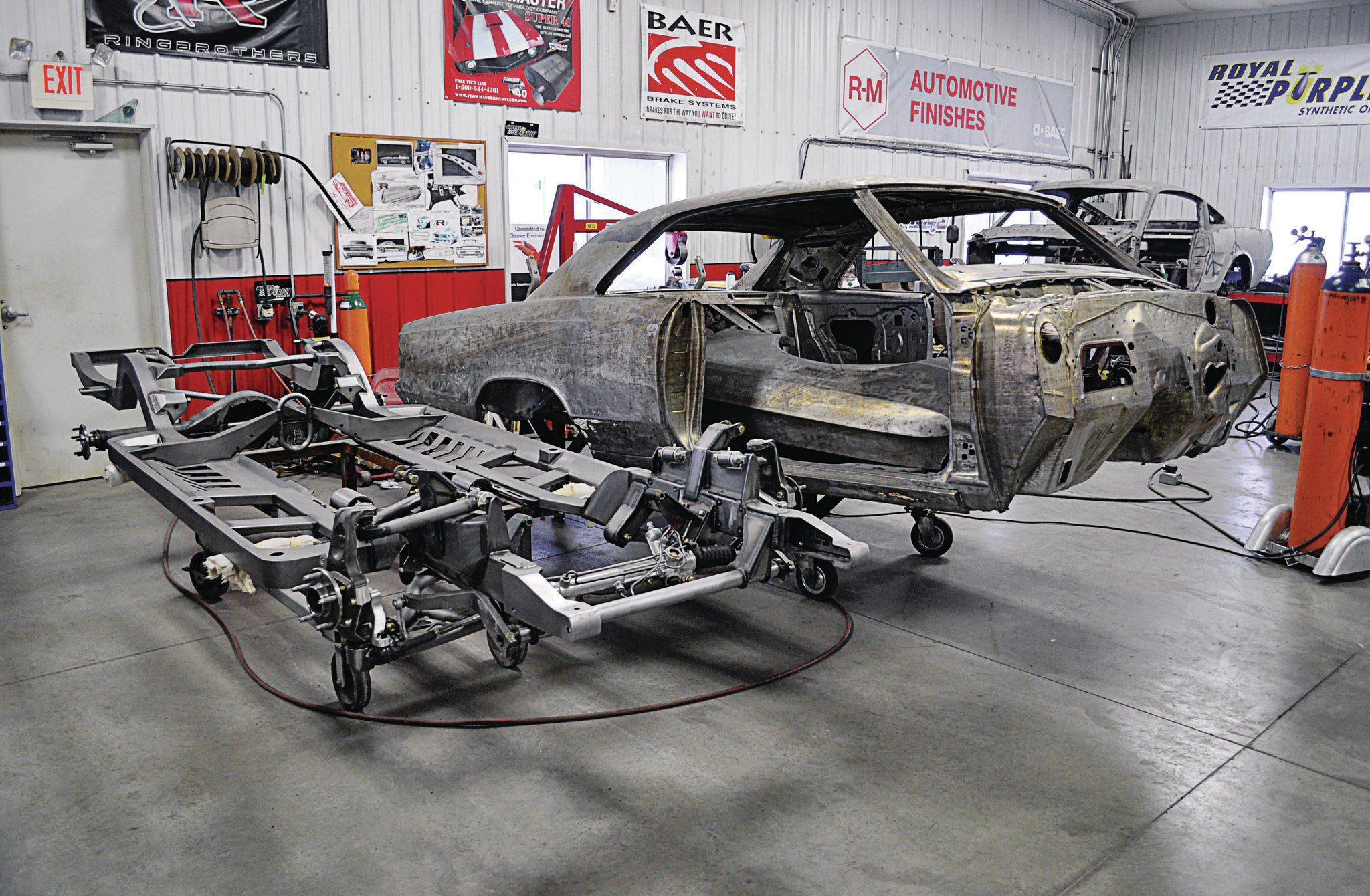 The holidays brought a Roadster Shop chassis and a dipped-and-stripped body to the Ringbrothers' Spring Green, Wisconsin, shop to begin Recoil's two-year build.