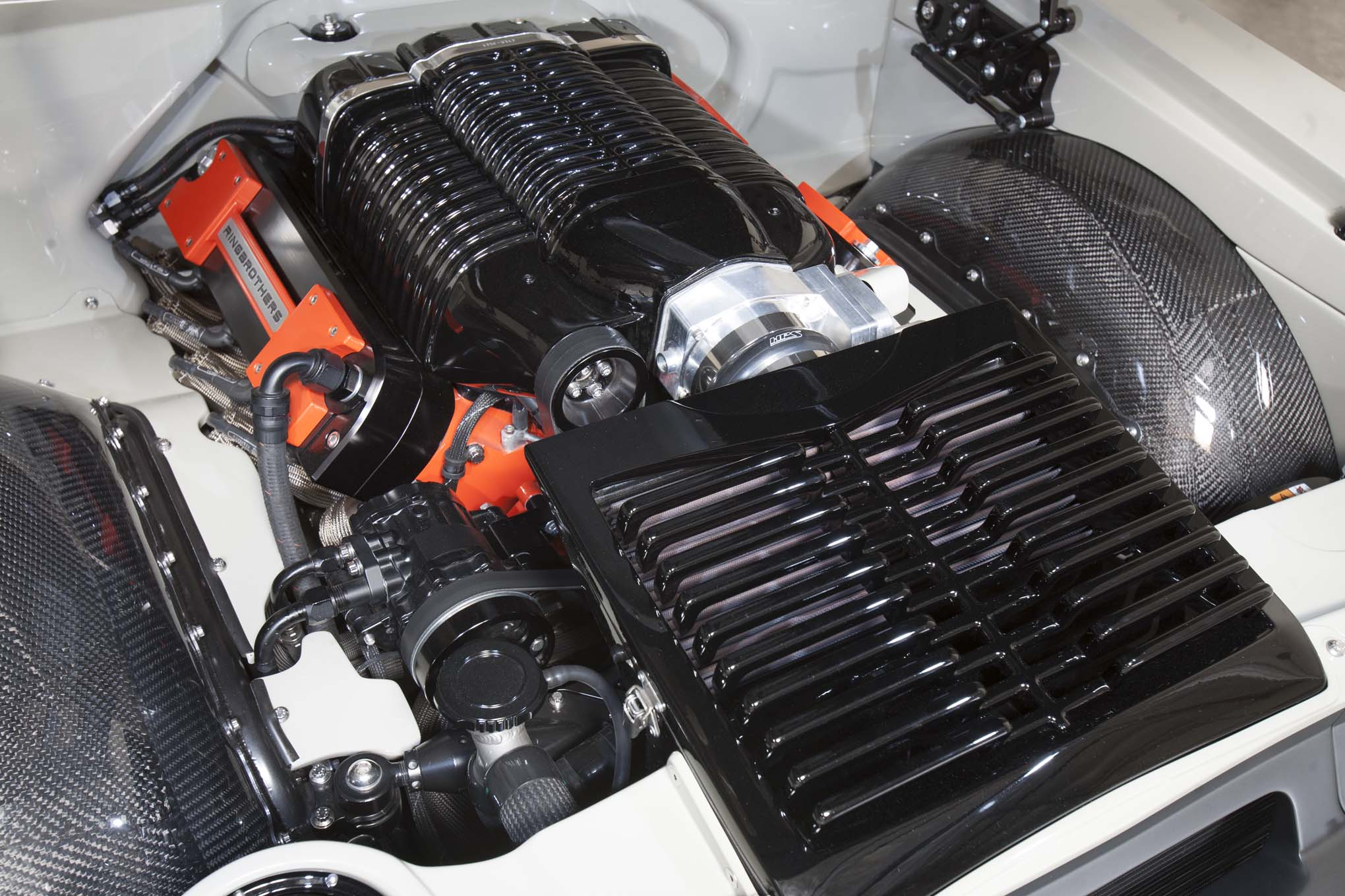 A Holley Dominator ECU tuned by Gary at Wegner Motorsports controls fuel and spark timing to the 416ci LS. Ringbrothers fabricated the ribbed covers on either side of the Whipple supercharger that hide the fuel rails and injectors. It also designed and built the custom air cleaner and valve covers. Below the core support, tucked out of sight, are the Afco radiator and Spal electric fans.