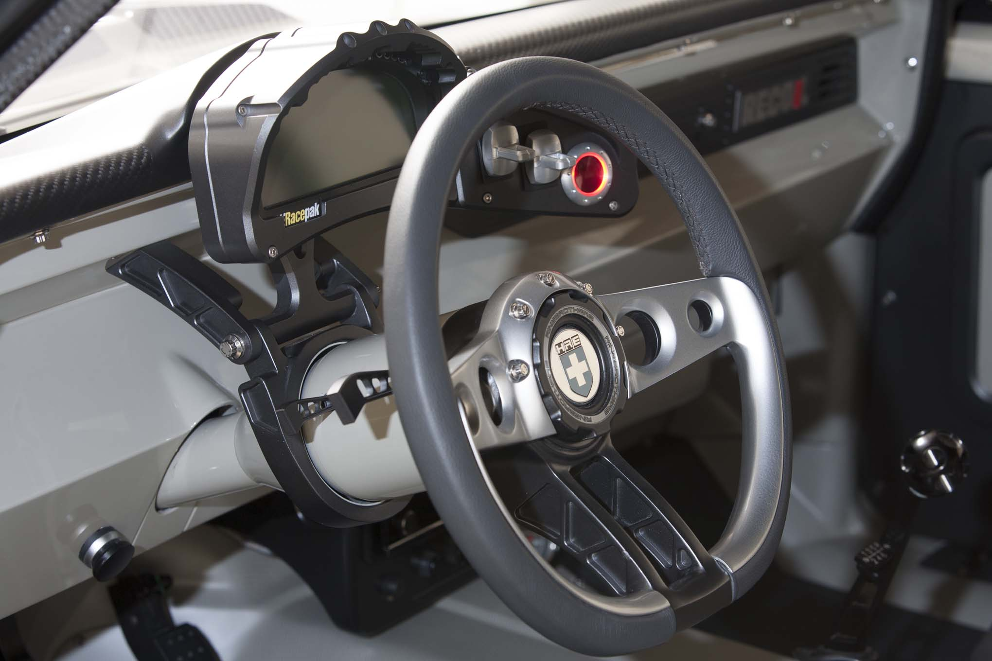The custom steering wheel built by Ringbrothers uses parts from its billet hood hinge lineup, the glowing start button is theirs as well. All engine data is efficiently displayed on the Racepak, keeping the driver informed with one glance.