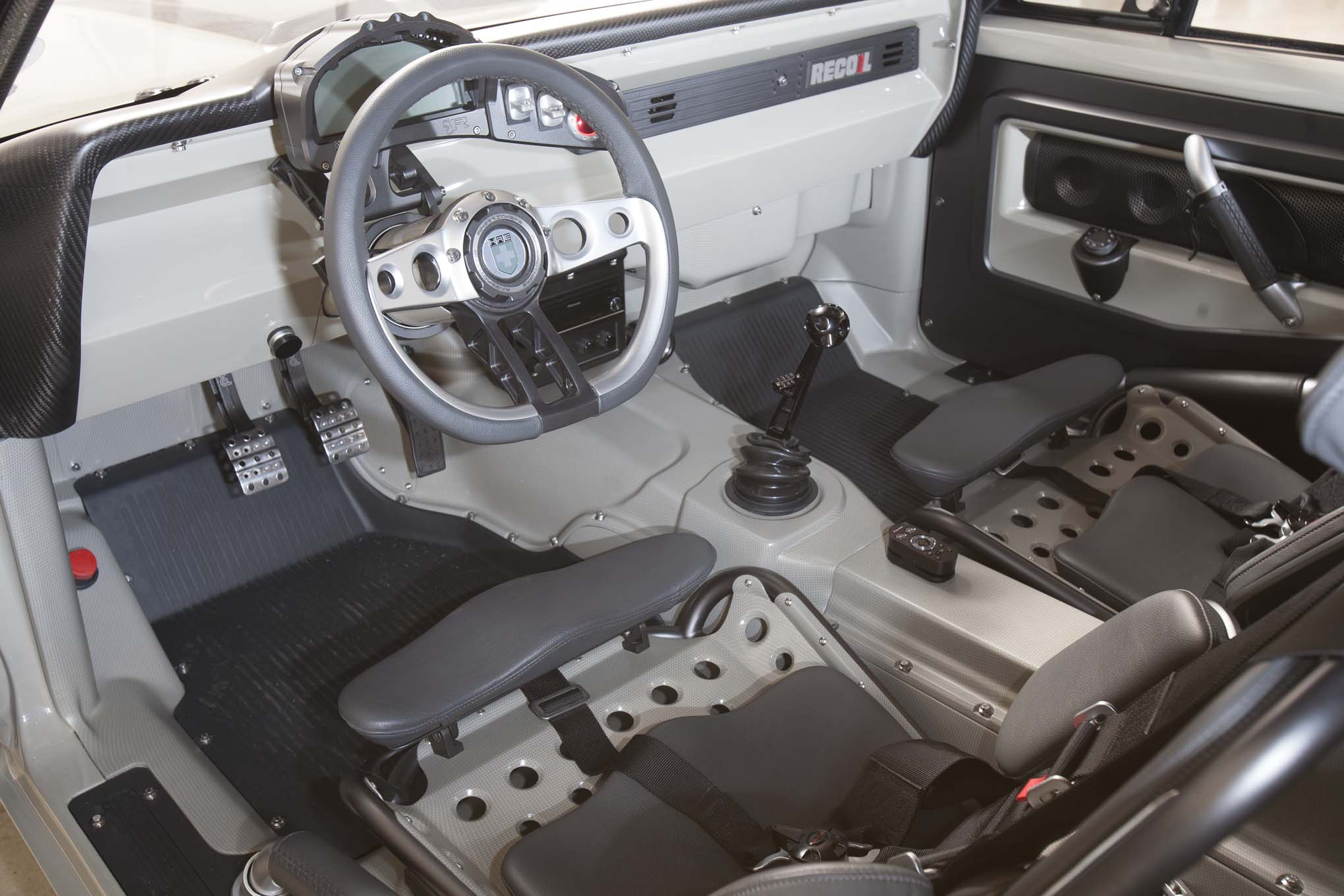 The interior is equal parts sci-fi and race car with buttons and distractions kept to a minimum. The billet-aluminum window switches are easy to miss, but the tiny Vintage Air A/C controls mounted in the center console are clearly labeled.
