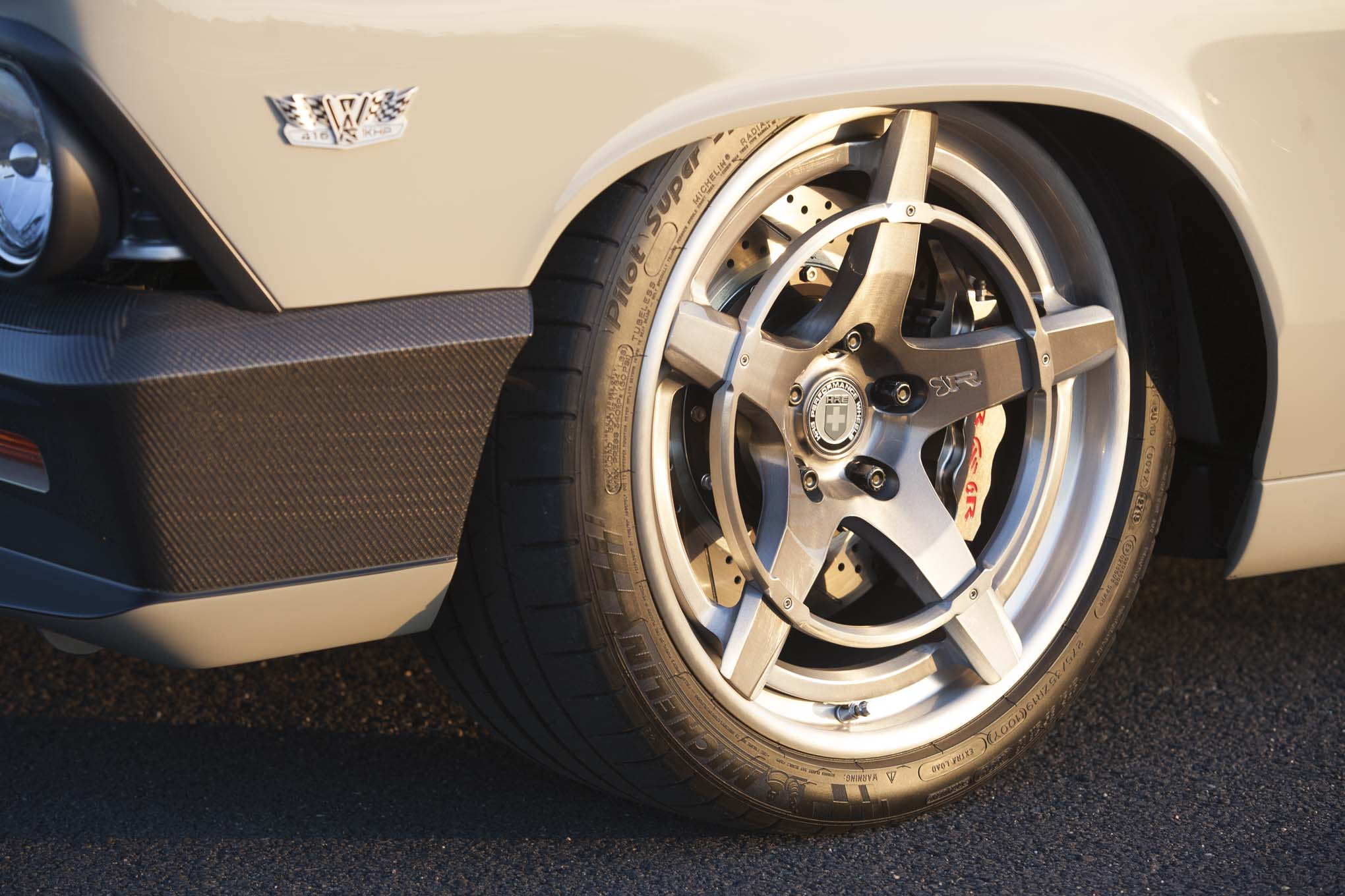 Brakes are from Baer, with 15-inch two-piece rotors in the front, 14-inch rotors in the rear, and six-piston calipers all around.