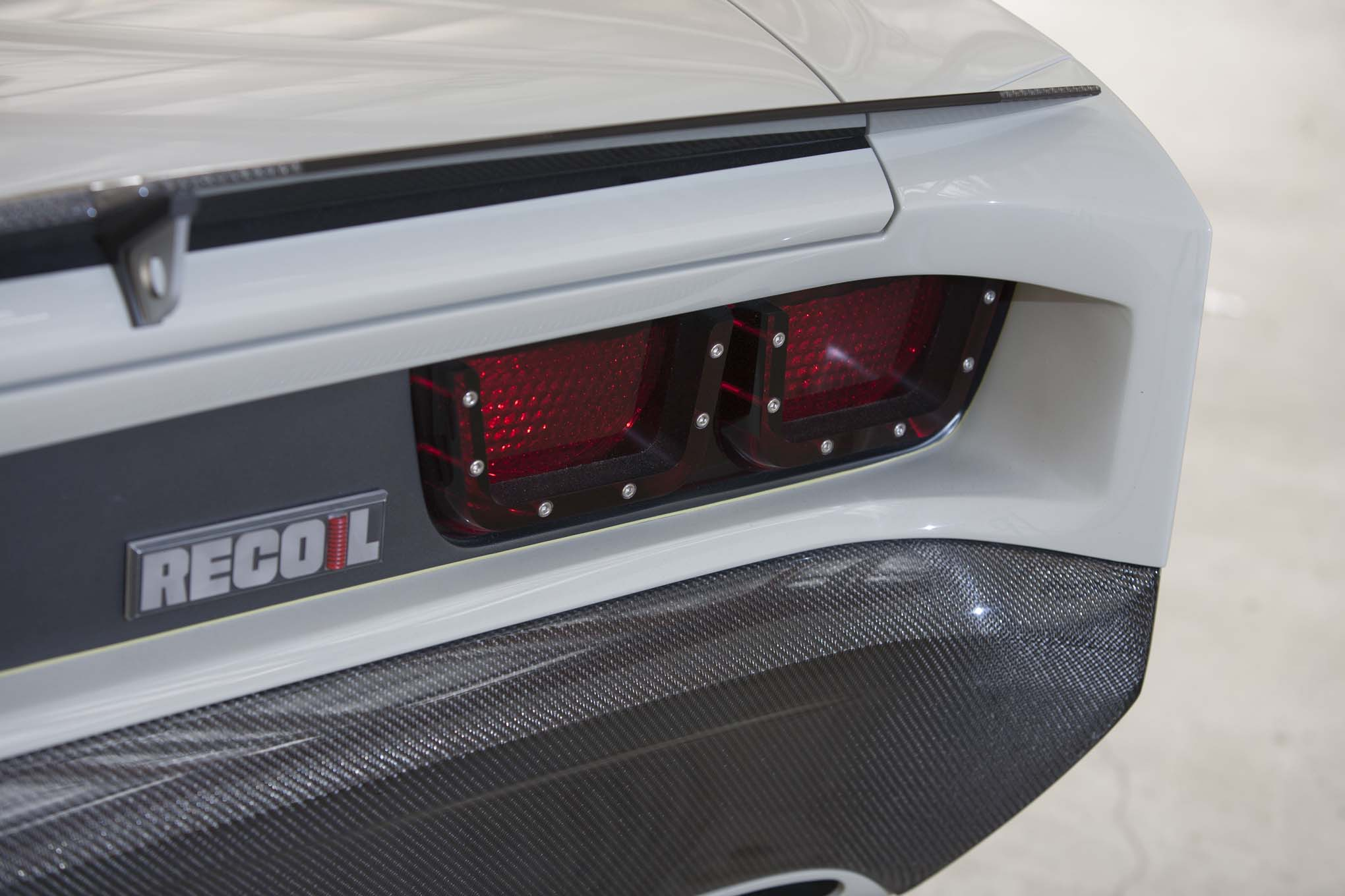 AM Hot Rod Glass taillights fit into a custom tailpanel. Note the gap between the body and the carbon-fiber bumper.