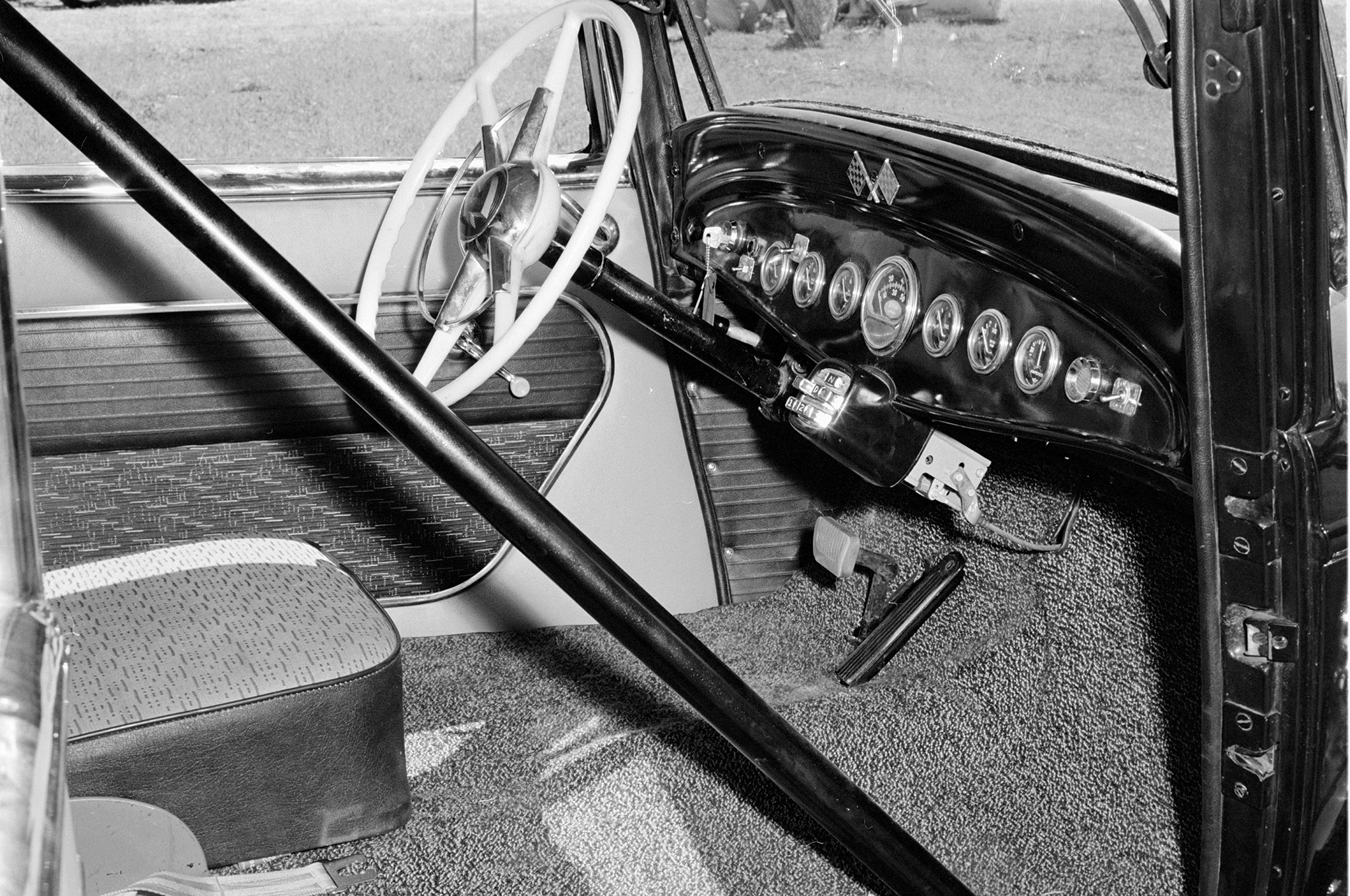 "Inside, the single seat and rollbar speak to Nick's dragstrip intentions. Note the under-dash box housing the push-button shifter for the TorqueFlite. ""Shift points are modified,"" said the HRM story."