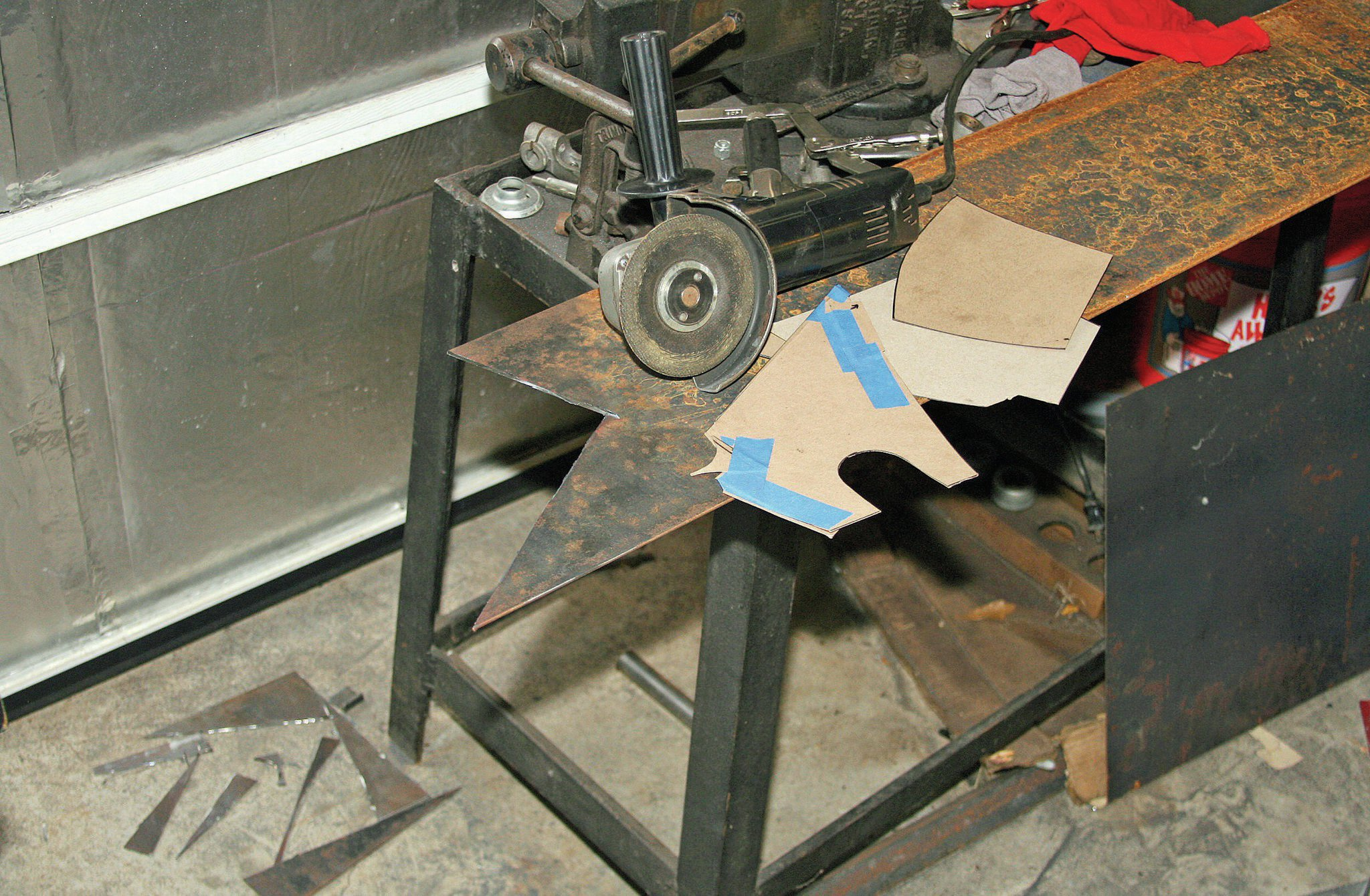 We used 1⁄8-inch plate, cut with a cut-off wheel on our angle grinder, to form the box that would hold the steering box. The 1⁄8-inch plate is plenty sturdy, but we wouldn't want to go any thinner.