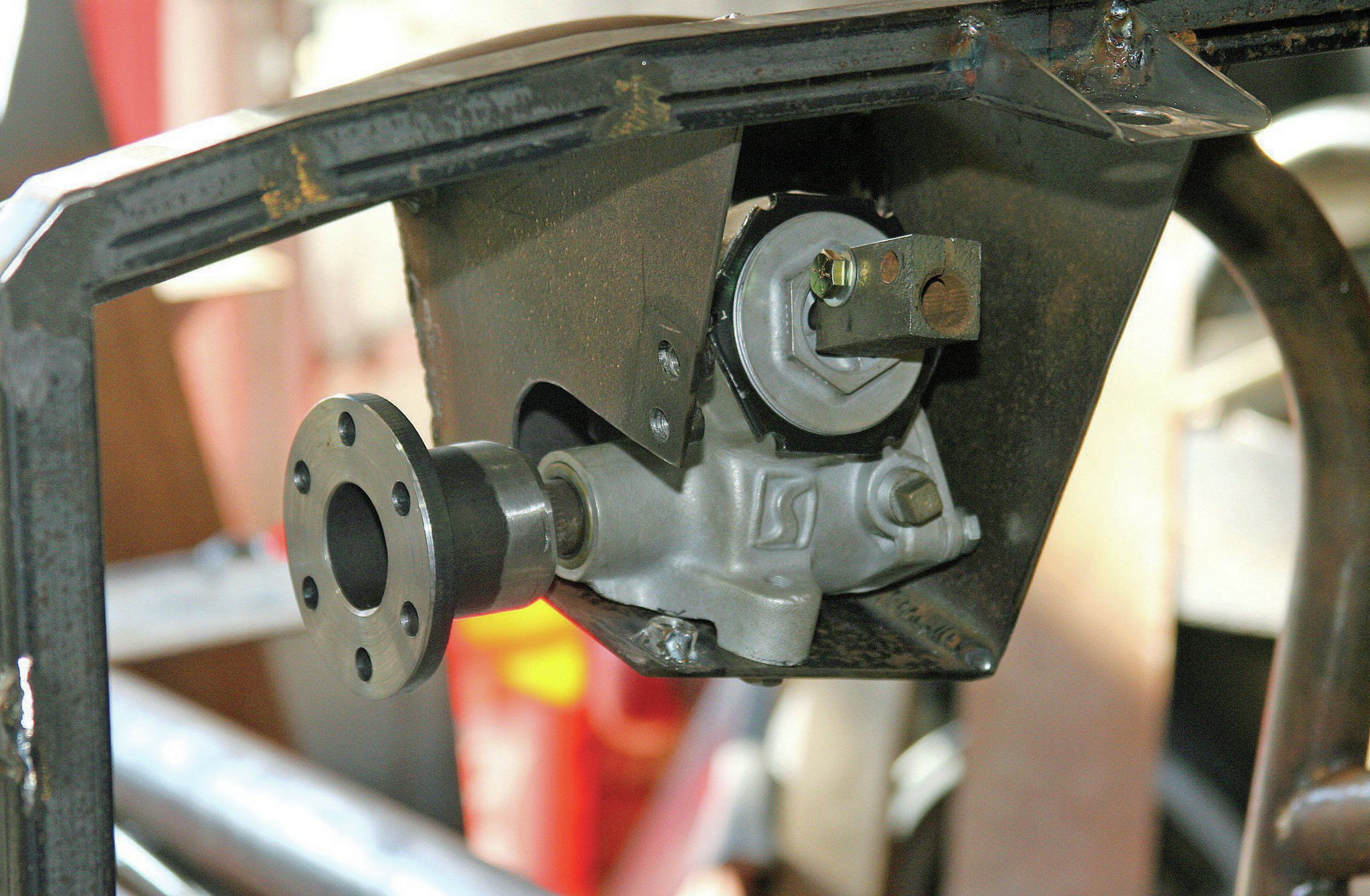 "The mounting box needed a hole or a notch to clear the pitman shaft and coupler. With as tight as we made the mount to ""wrap"" around the steering box, we put in a notch so the steering box can easily slide in and out."