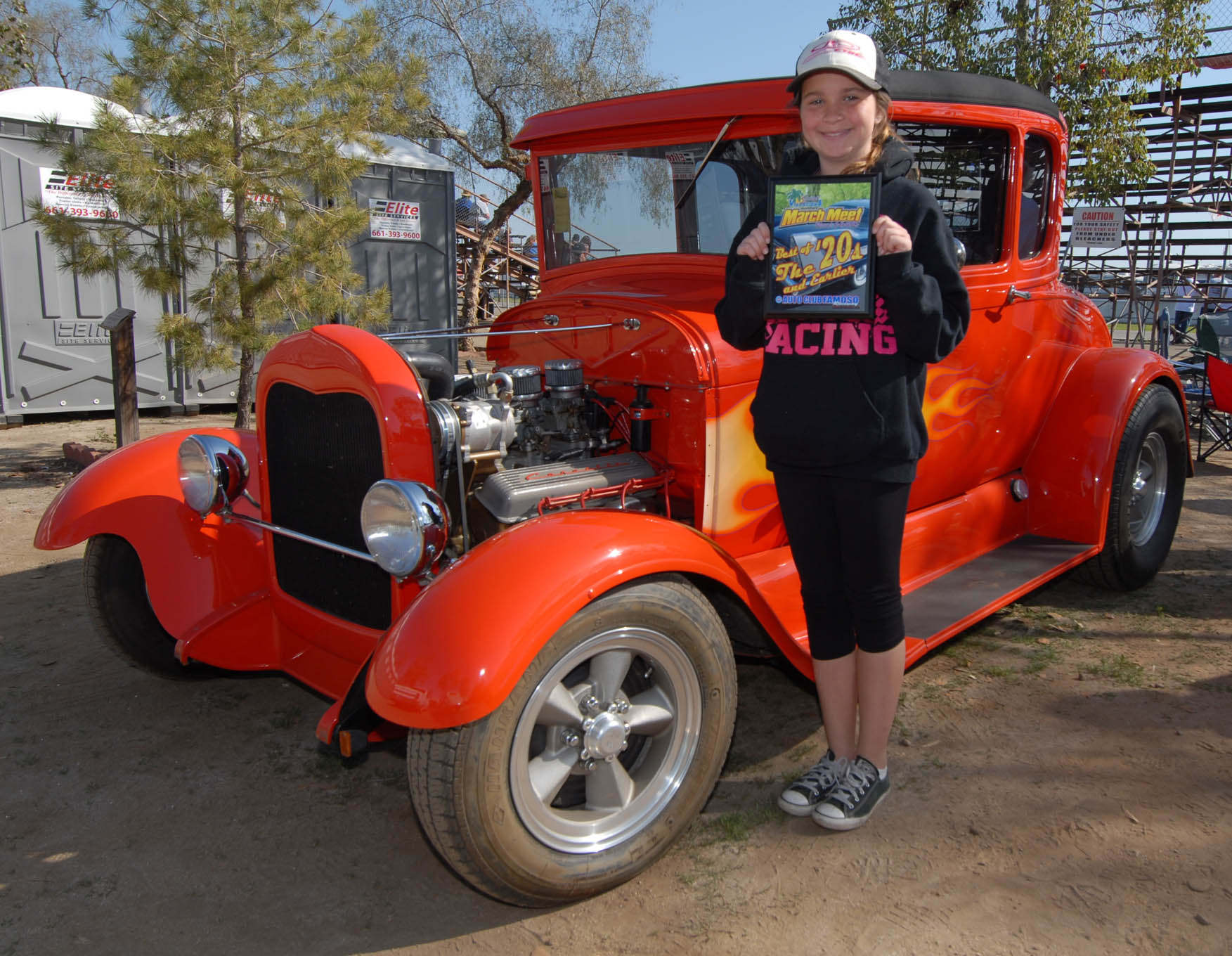 """This year's youngest and cutest winner had to be Paige Russell, a repeat March Meet attendee whose grandfather charged her with keeping his all-steel '29 shiny all weekend. When car-show organizers picked the squeaky-clean coupe as """"Best of the '20s,"""" grandpa Phil Tessier rightly awarded the plaque to Paige."""