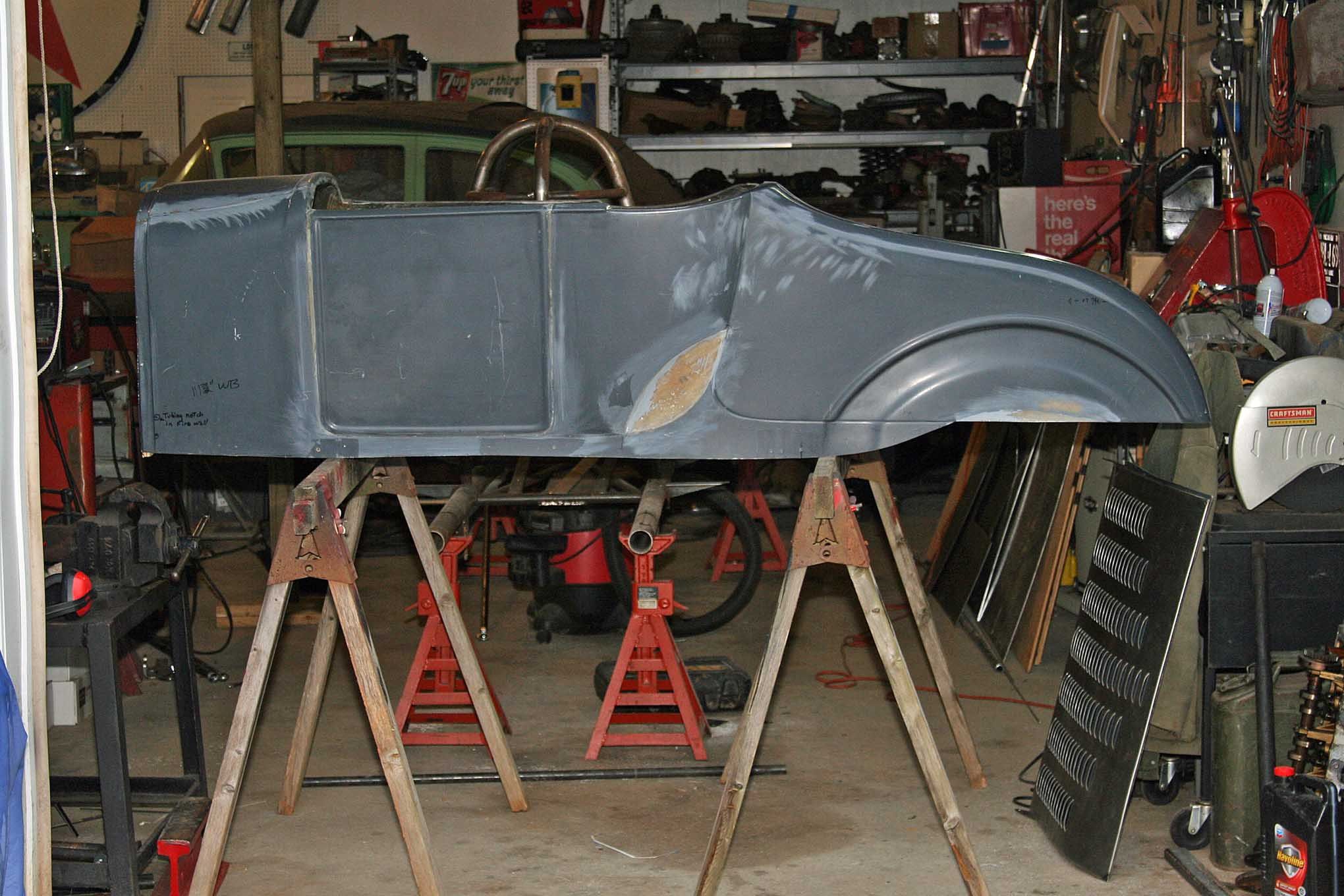 "Back home at our shop, the now one-piece body with notches, squared-off wheel opening bottom, and bobbed tail panel is just about ready for its first trip to the paint shop for primer. Visually and mentally, the tubs and the molded-in doors really changed it from ""a body"" to ""a race car."""