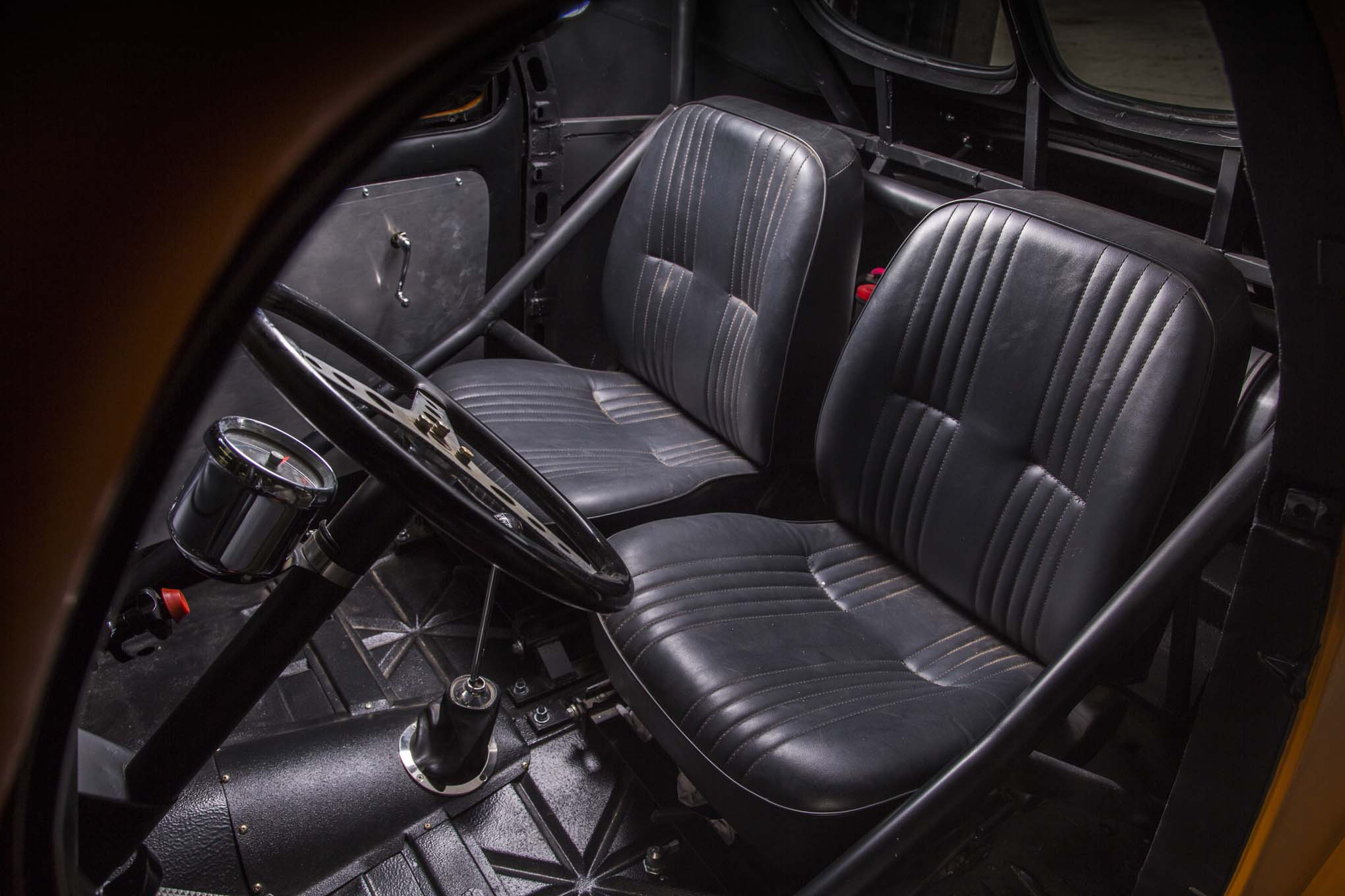 The interior in Ernie's Willys is a little more plush than in the Chevy—hey, upholstery!—but still purpose-built. He retained much of the car's stock dashboard and made the steering column himself.
