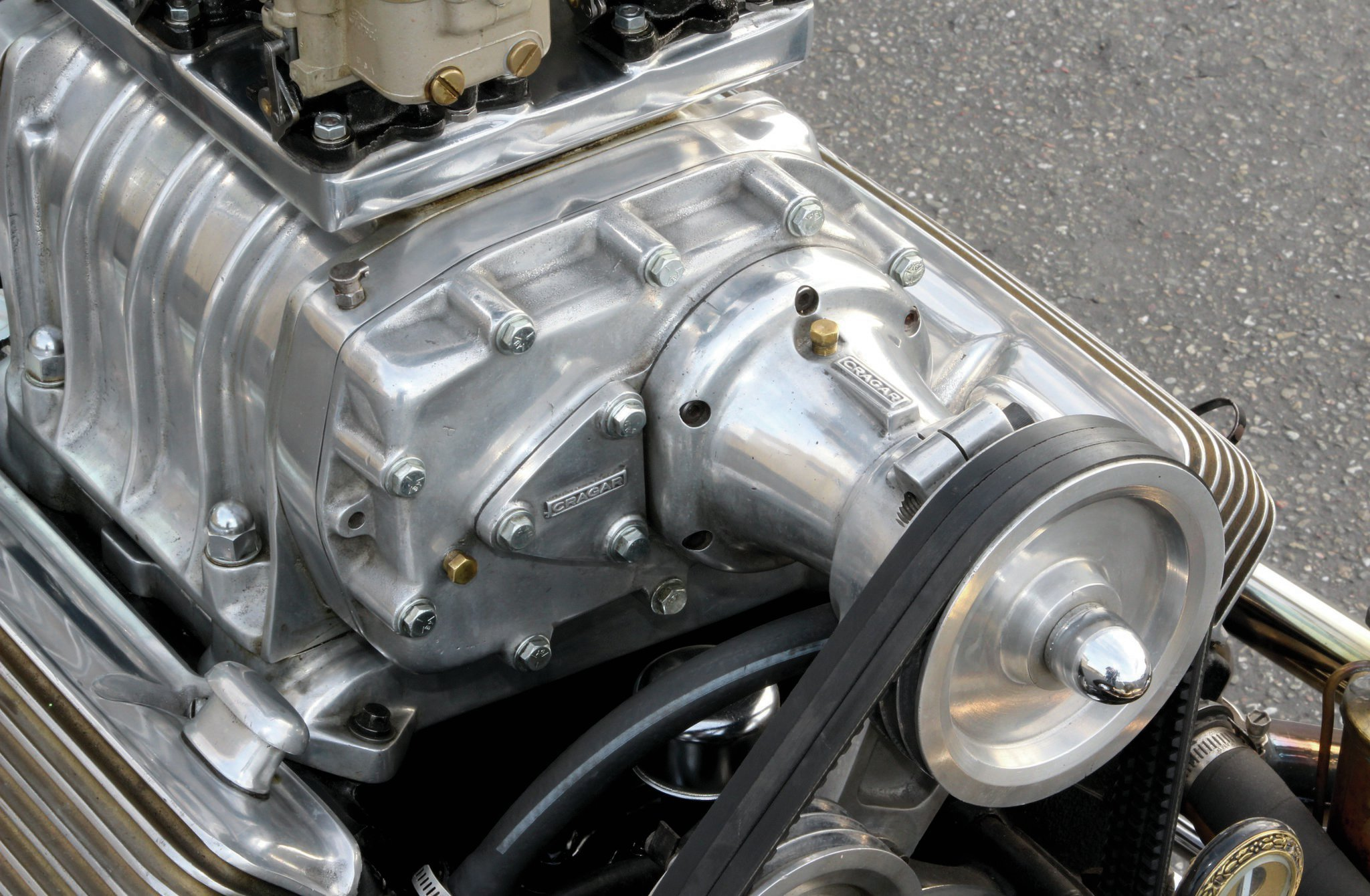 The '55 Cadillac 331 engine was bored 0.100 over to almost 350 ci. The engine also has what is said to be the Holy Grail of Cadillac speed parts, a Cragar 4-71 supercharger. This was installed in 1958 along with the six Holley 94 carburetors. Underneath the Edelbrock finned valve covers, the engine has Isky adjustable rocker arms along with an Isky cam.