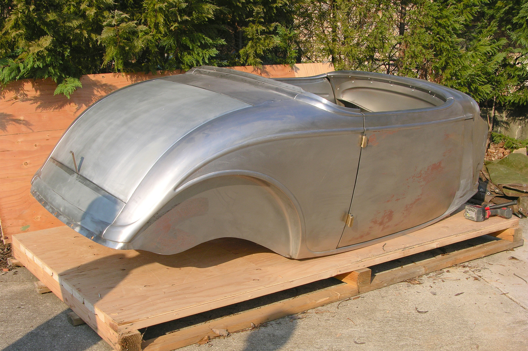 The reproduction 1933 Ford roadster body is the product of Steve's Auto Restorations (SAR) in Portland, Oregon. This body boasts a major change from the standard SAR roadster body because the doors are longer for better ingress and egress.