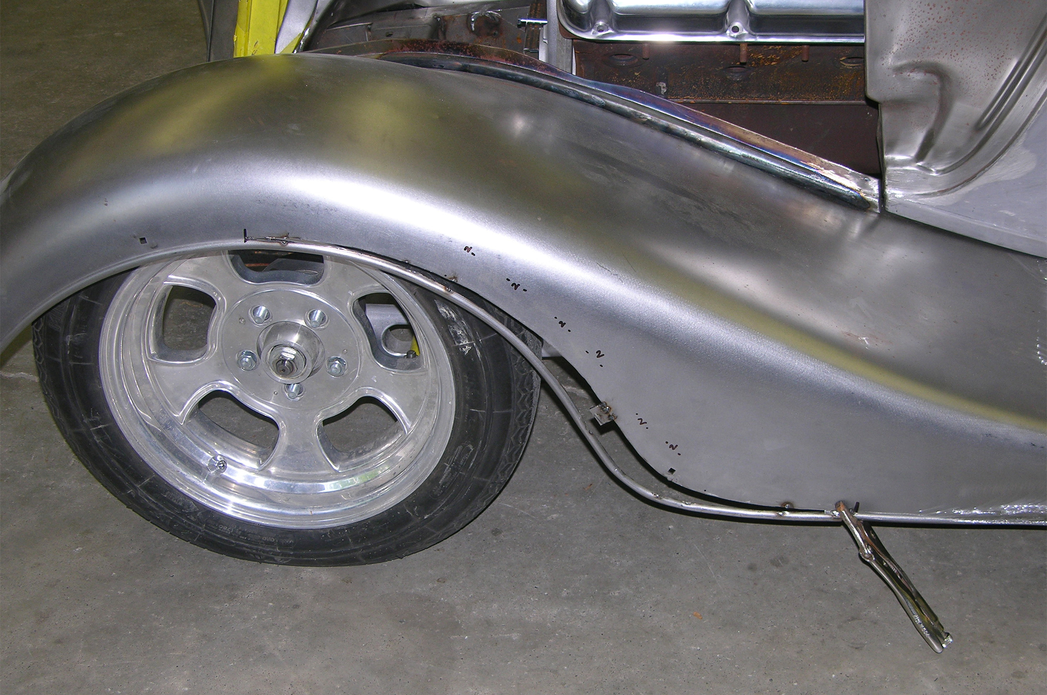 Since the front wheel centerline is slightly ahead of where it would be located relative to the stock location within the fender, the fender bead gets tightened up around the tire, which gives the illusion the car is lower and also follows the wheel arch better now that the car is so much lower.