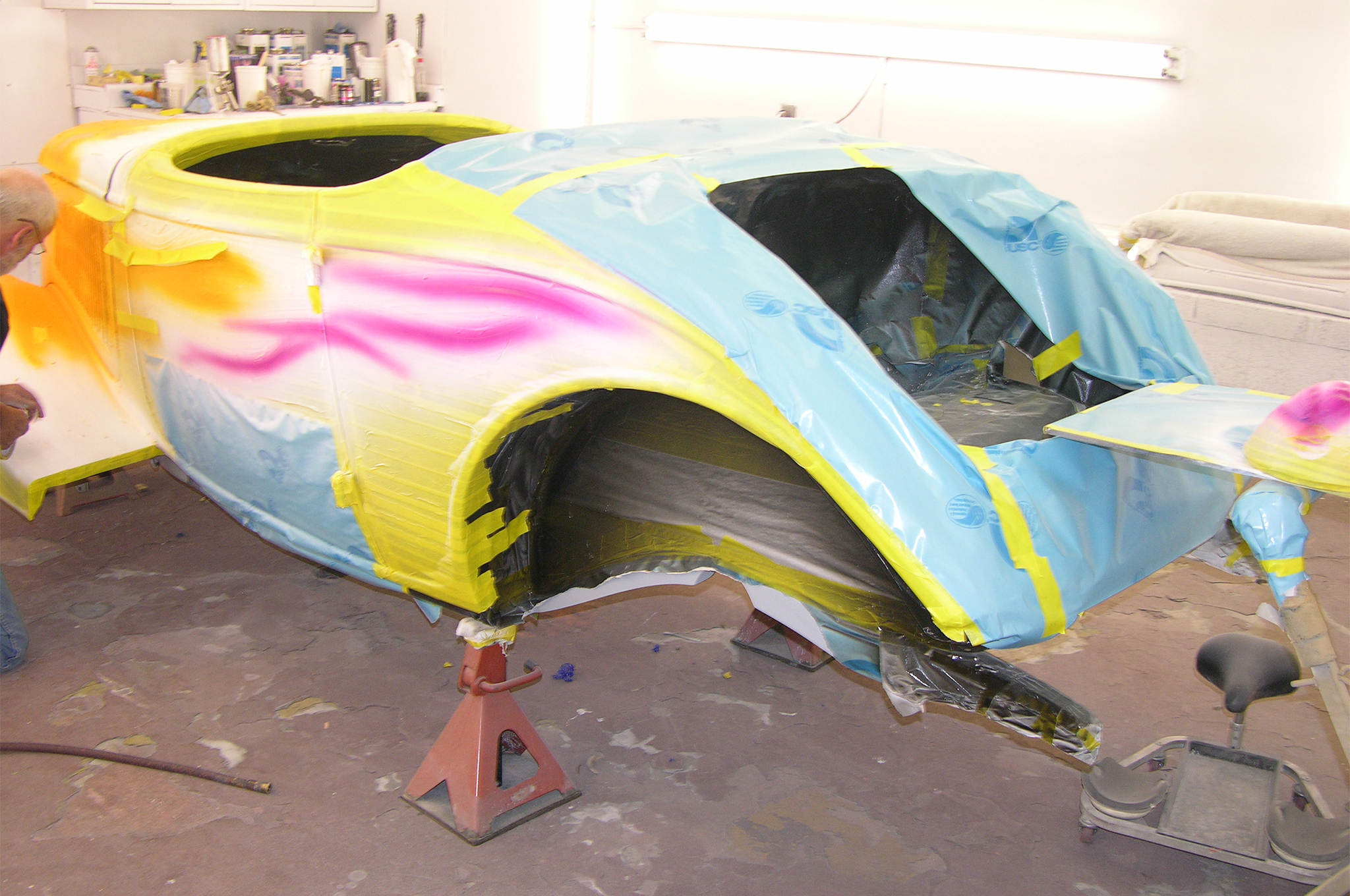 The final magenta of the flame tips has been shot, and once the tape and paper are removed, the car will be ready to be cleared out.
