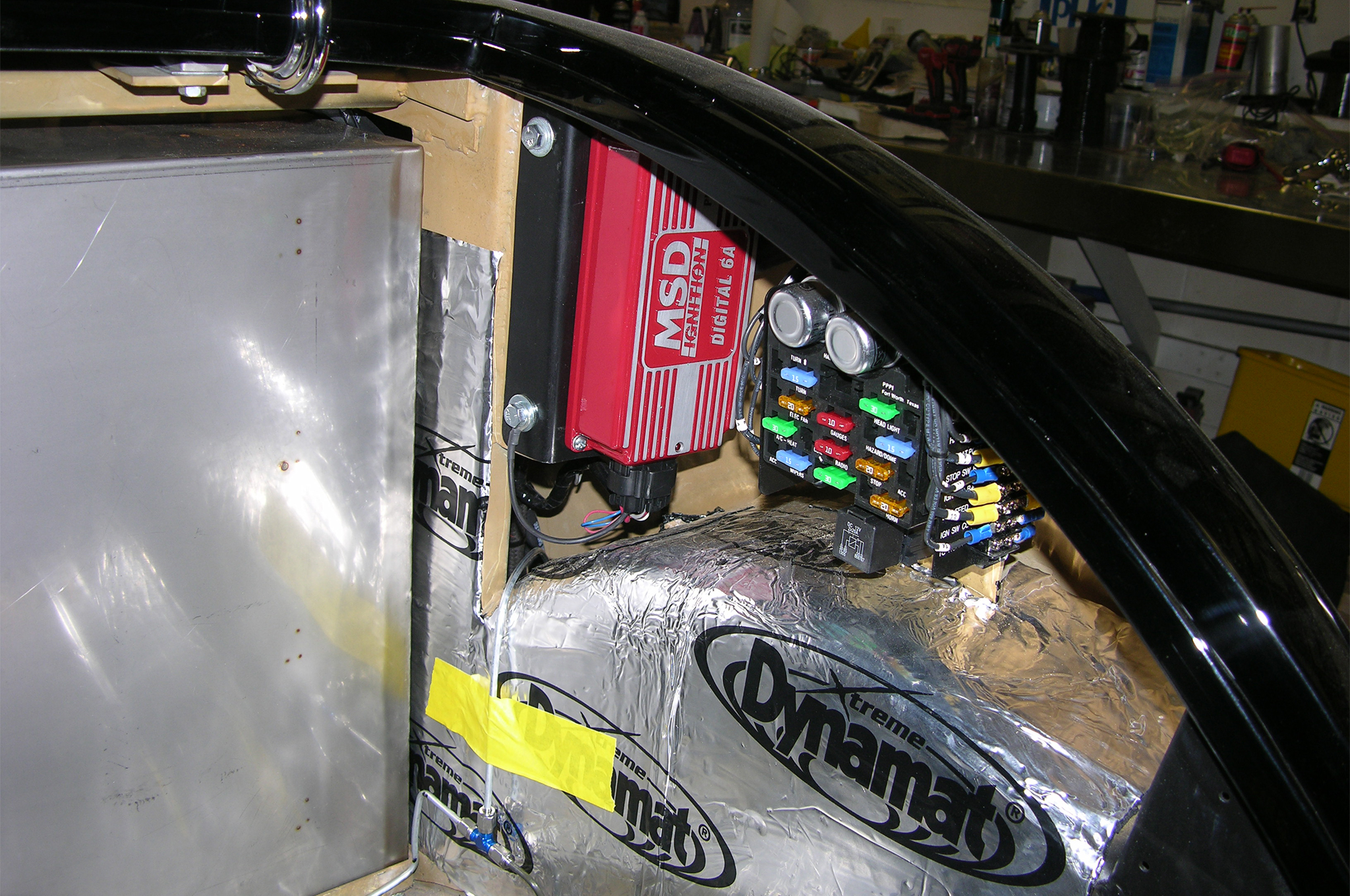 The wiring has been installed as has the stainless gas tank, insulation, and other components that install into the body to prepare for upholstery.