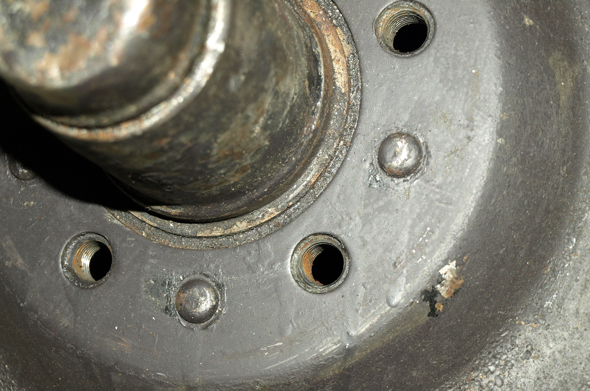 This close-up view of a 1933 Plymouth front brake drum shows the tapped wheel-bolt holes used through the end of the 1954 model year. Many modern cars use bolts too. There's no inherent disadvantage.