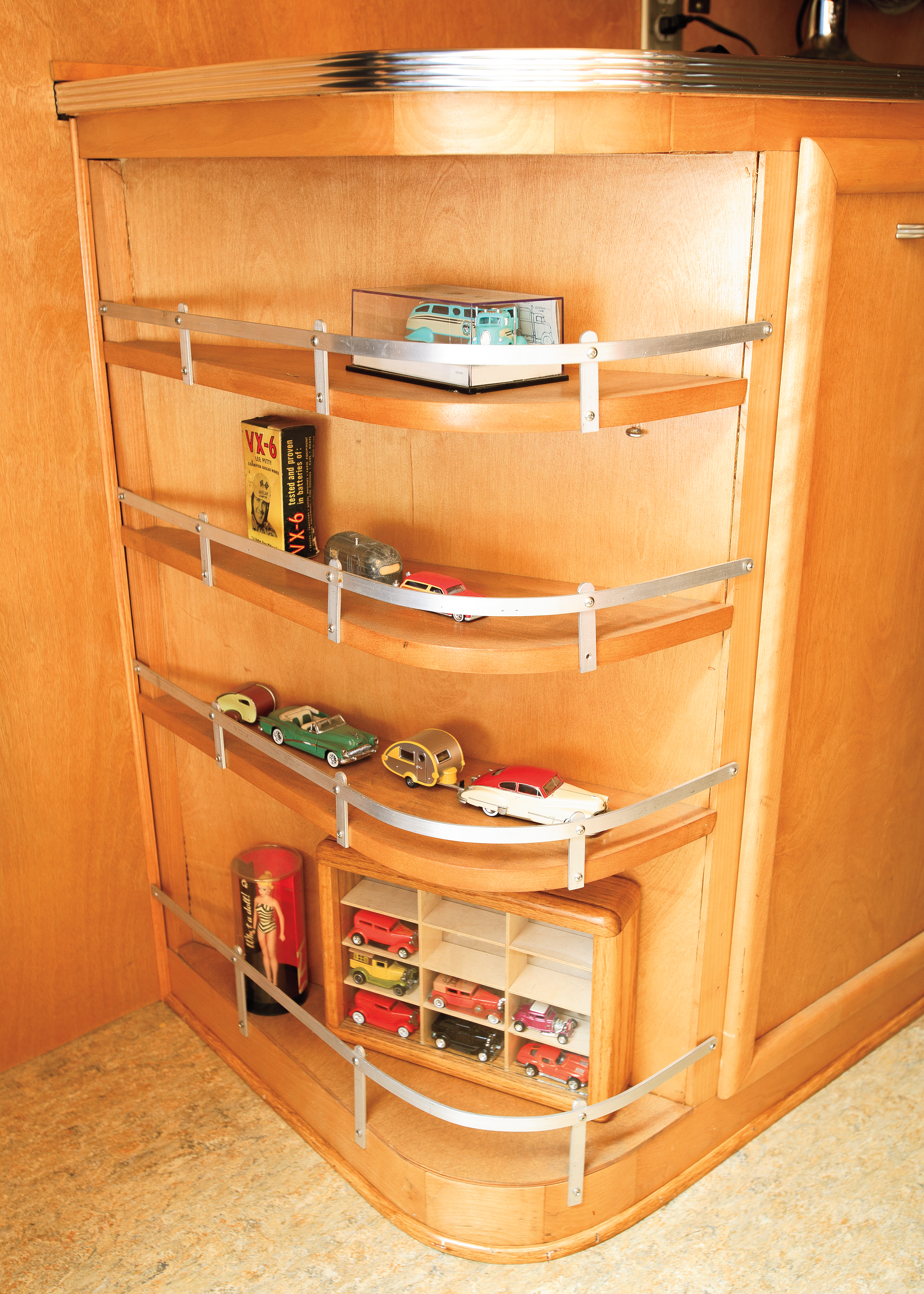 Larry really went all-out on creating the cabinets for his trailer. Small scale models of other car and trailer combos fill the shelves, along with a vintage box of VX-6 Lee Petty battery additive.