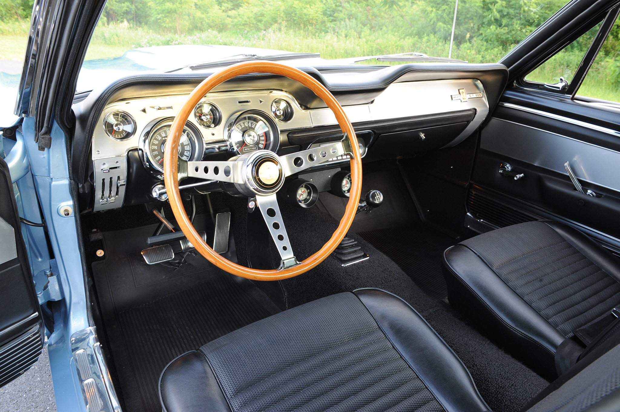 The 1967 Shelby used Stewart-Warner Green Line oil pressure and ammeter gauges mounted below the dash in a modified Rally-Pac housing. While these are original to Shawn's G.T. 500, they are now available in reproduction.
