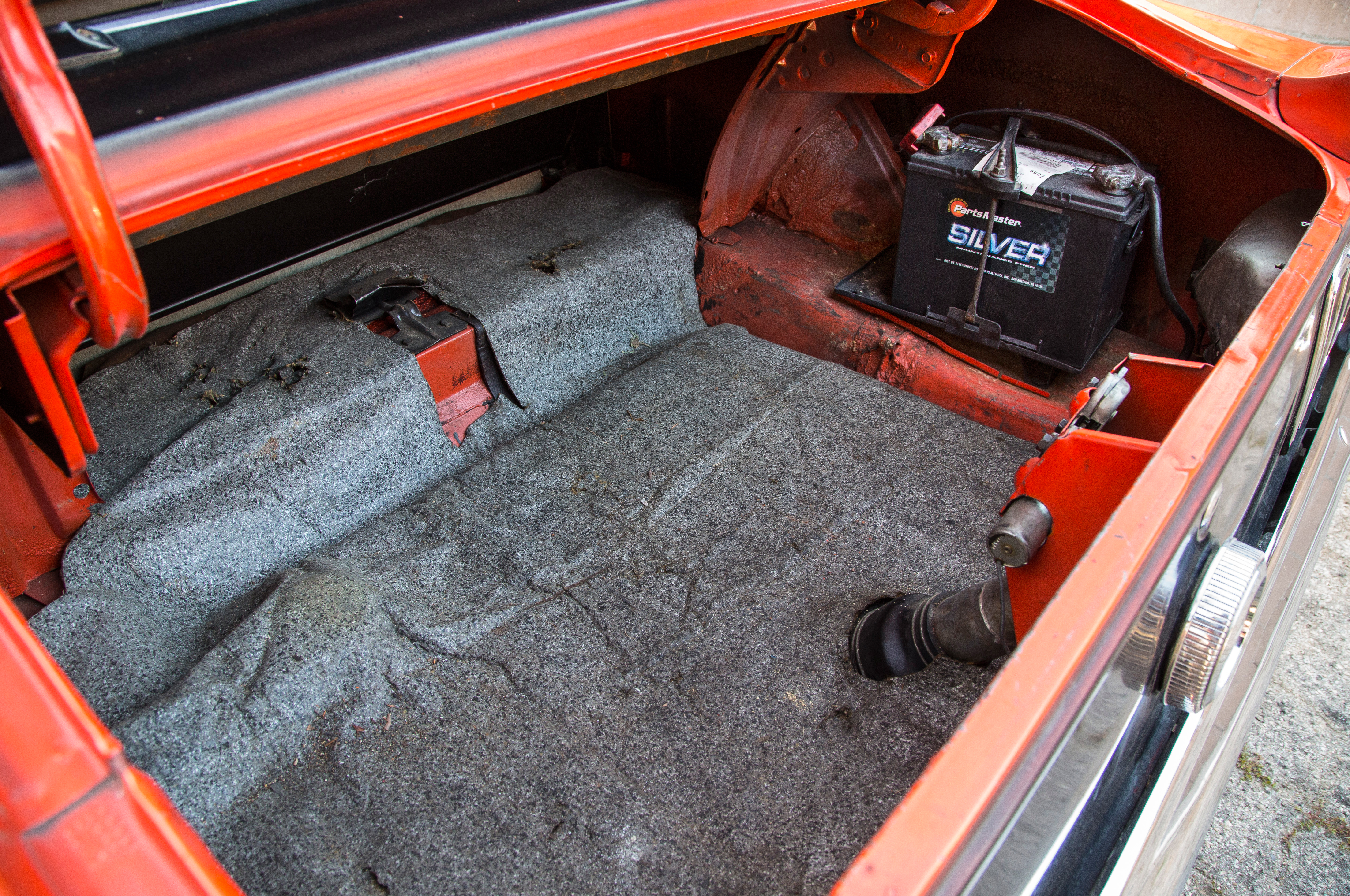The big 429 took up so much space in the Mustang's engine bay that many components—like the suspension mounts—had to be relocated. There was no room for a battery, so it was put in the trunk, all the better to aid traction at launch.
