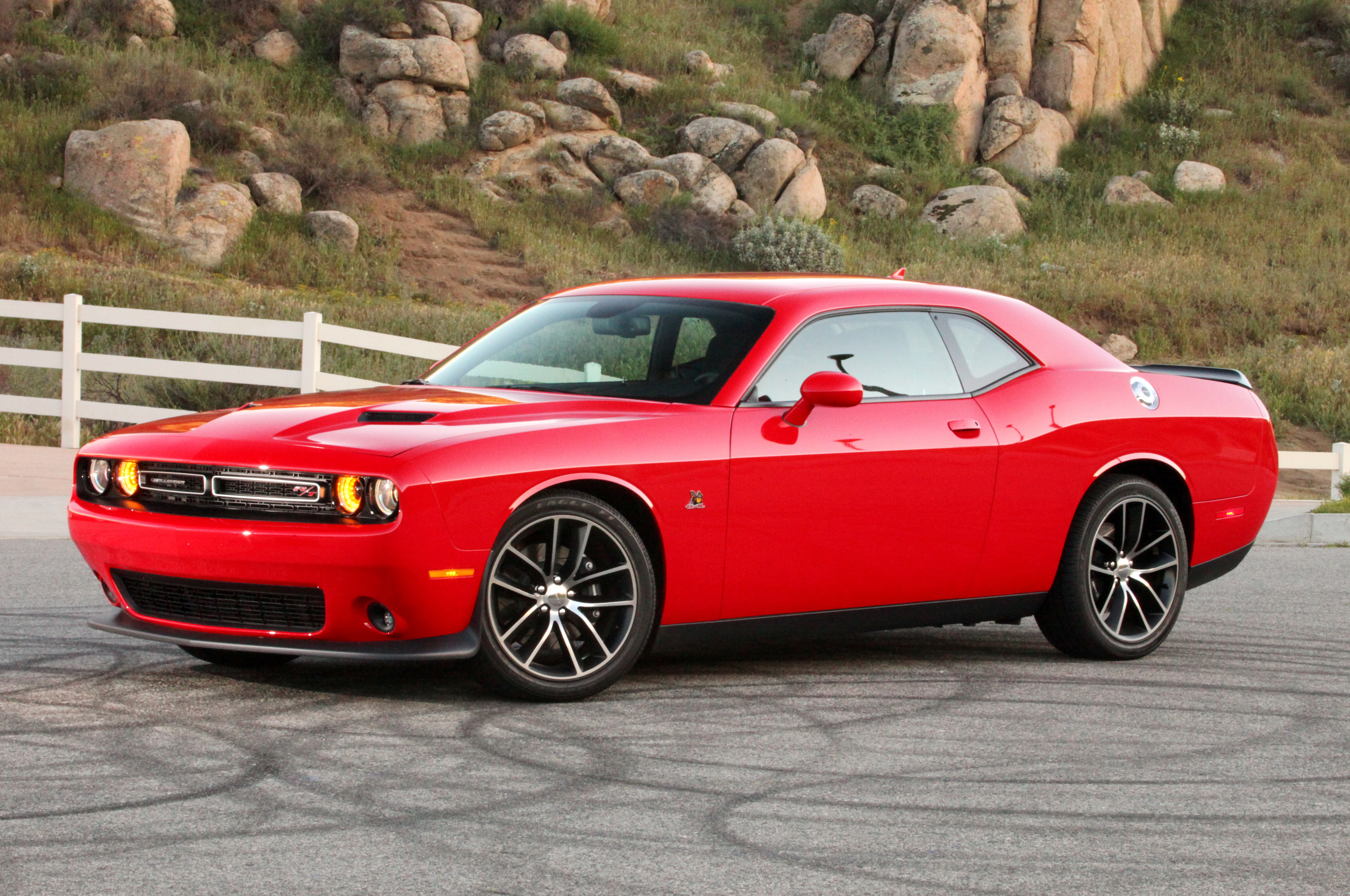The '15 Dodge Scat Pack Challenger is the best performance bang-for-the-buck going, with 485hp from an SRT-sourced 392ci Hemi, upgraded suspension and brakes, unique Scat Pack styling, and a price under $40k.