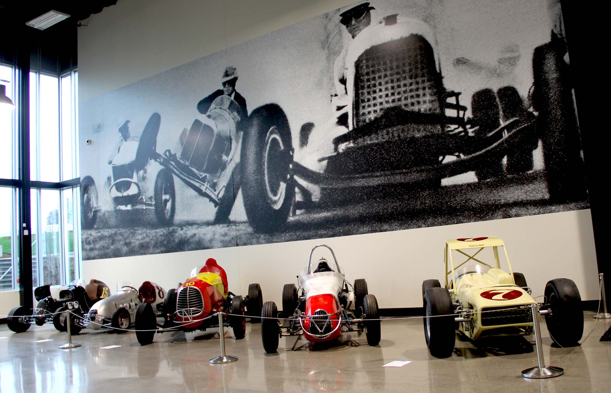Though the museum attempts not to be provincial, this display is a celebration of the rich history of open-wheel racing from the Pacific Northwest. The museum has attempted to collect some of landmark sprinters and midgets, including the Eddie Kuzma–built midget driven by Gordy Youngstom, the Kuzma-built aluminum midget of Harry Meyer, the Nelson's Ranger Special tank engine big car, Del McClure's Chrysler-powered big car, and Bob Gregg's Chinhauser Modified.