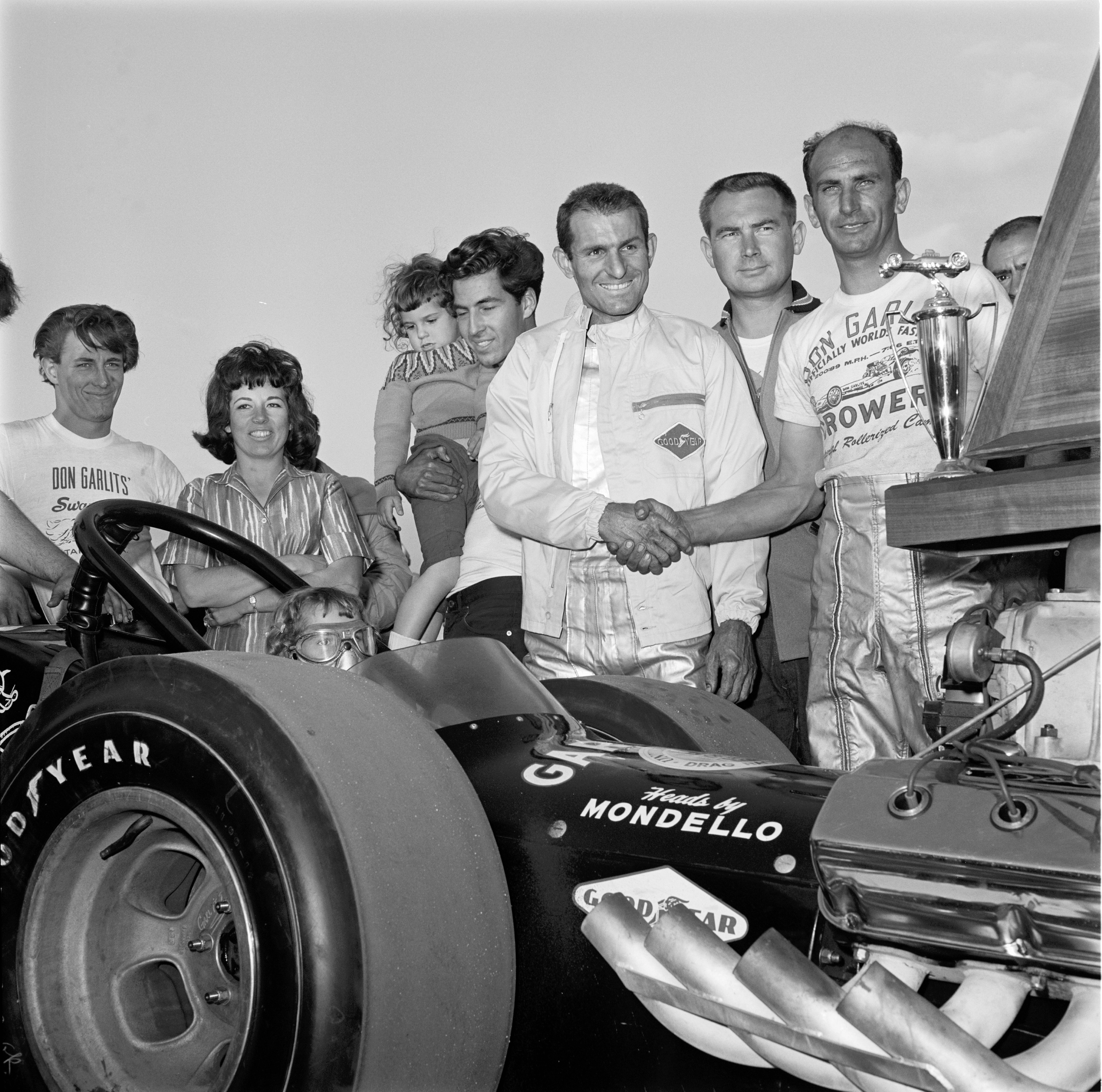 Of 120-odd fuelers attempting to make Bakersfield's 64-car show, three belonged to Don Garlits. Two surfaced in Sunday's feature finale, won handily by Big himself; the third made it to the last round of a consolation program. Shown celebrating victory in the only major event to have eluded him since March 1959 are (from right) Top Fuel runner-up Marvin Schwartz, Bruce Crower, Don, Number-Two Eliminator runner-up Connie Swingle, daughters Donna and Gay Lyn (in car), and wife Pat.