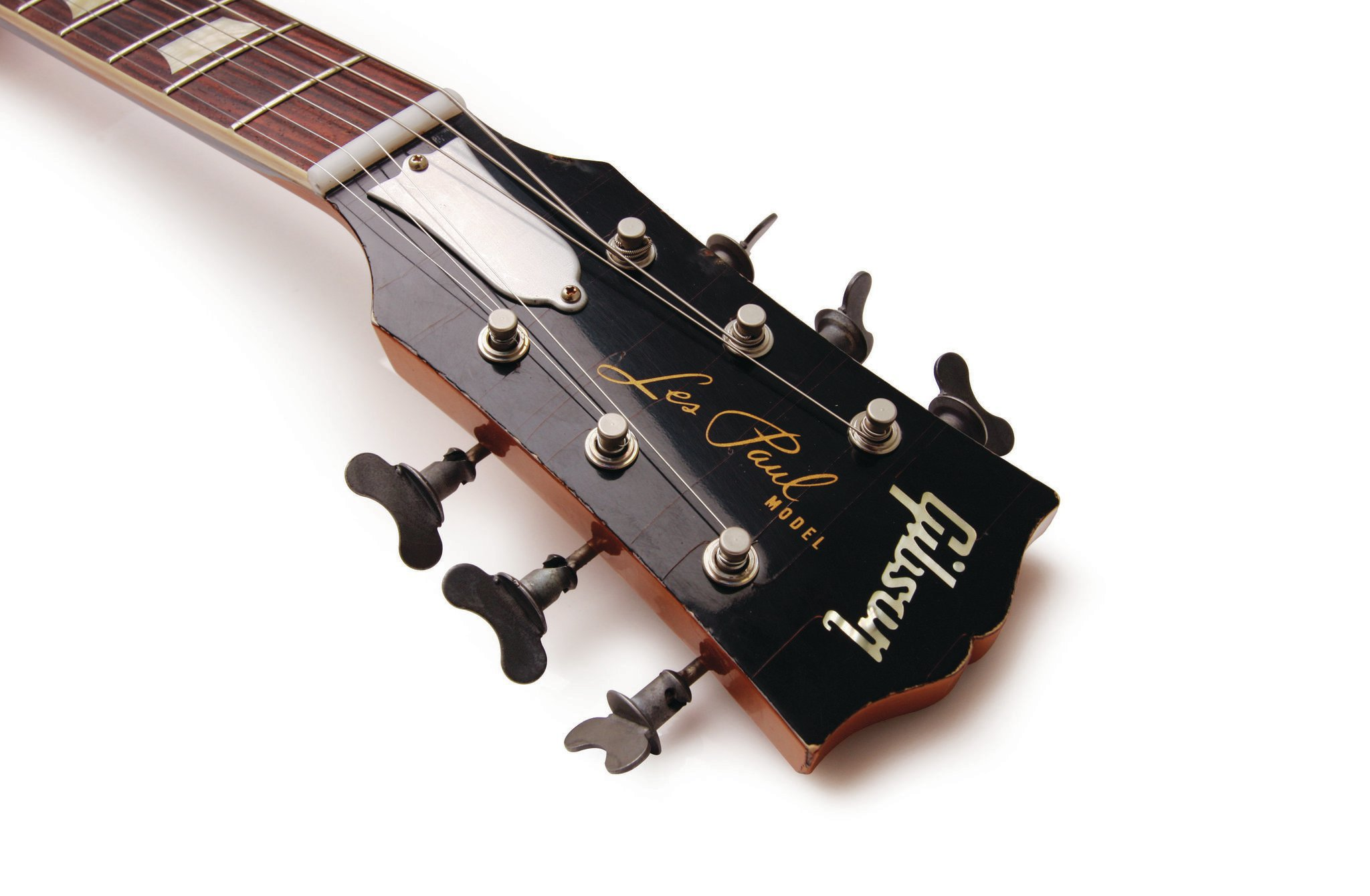 Quarter-turn fasteners are used on the tuning pegs.