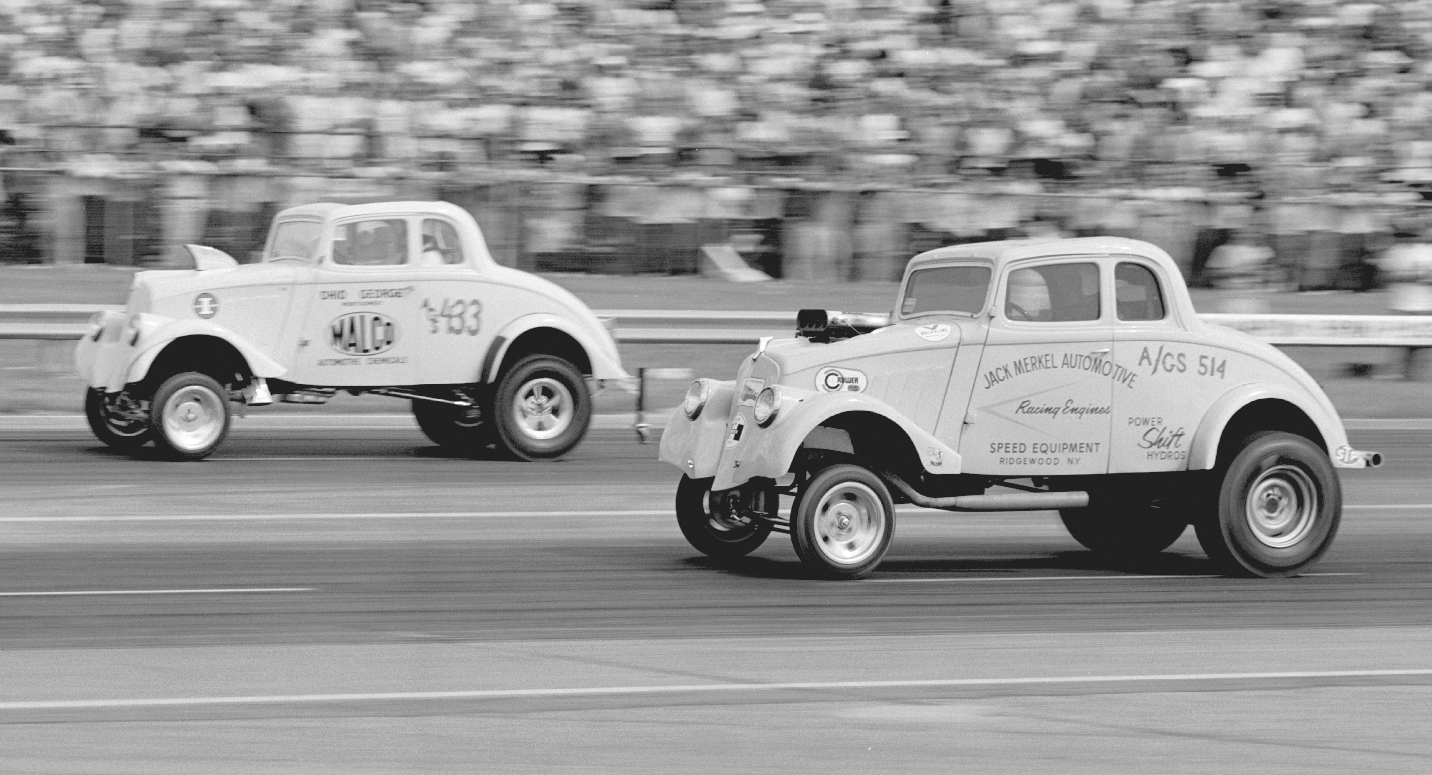 The biggest upset of NHRA's biggest show saw Jack Merkel's month-old Willys hand George Montgomery his first-ever Nationals A/GS defeat, snapping a streak started in 1959. Jack's 9.98/142.18 topped Ohio George's 10.07/134.73, after which Merkel fell to eventual class winner Doug Cook.