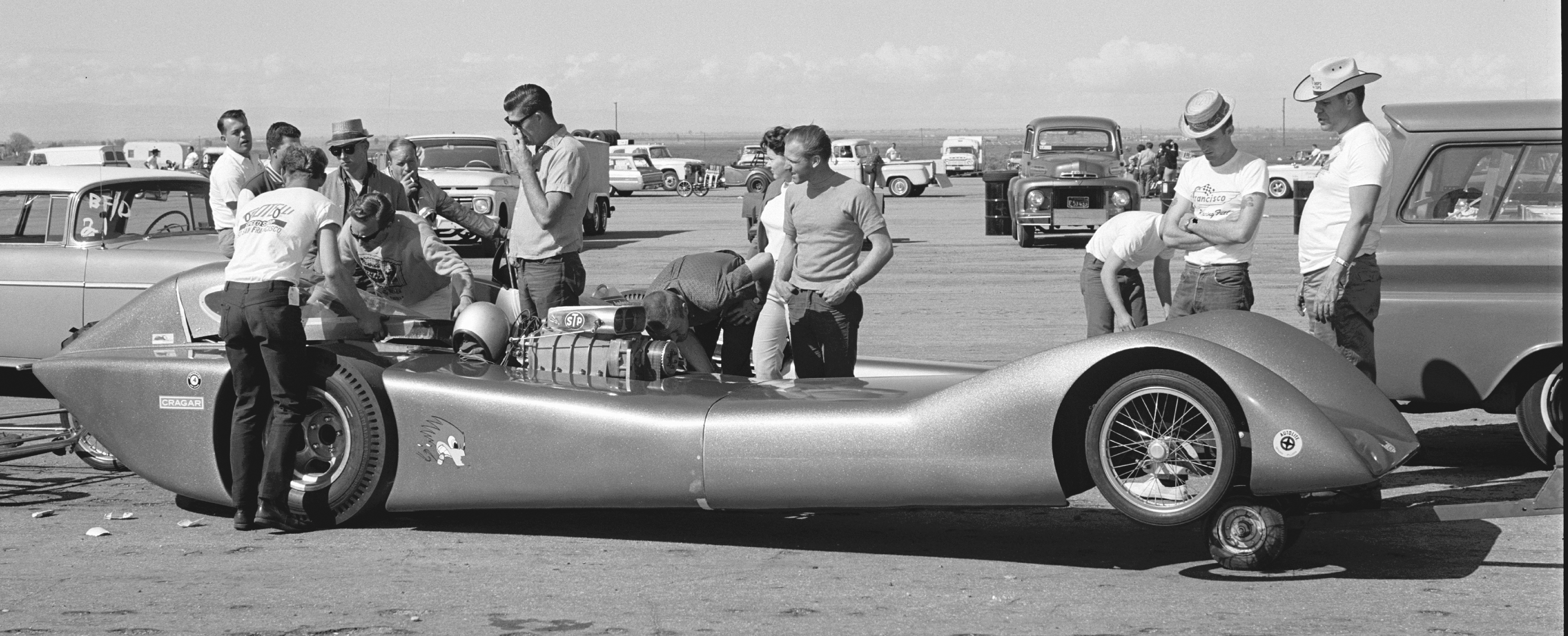 "Interest in streamliners drooped dramatically after conventional cars reached 200 mph, yet Jocko Johnson wasn't giving up on aerodynamics. He wrapped this all-fiberglass body around the proven combination of a Woody Gilmore ""Flexy-Flyer"" chassis. Making no mention of the resultant pile of panels, HRM's May '65 March Meet coverage reported only that ""Frank Cannon's Chrysler pushed it to 196 mph, 8.15 sec. e.t., but bugs were evident. New frame and improvements are scheduled."""
