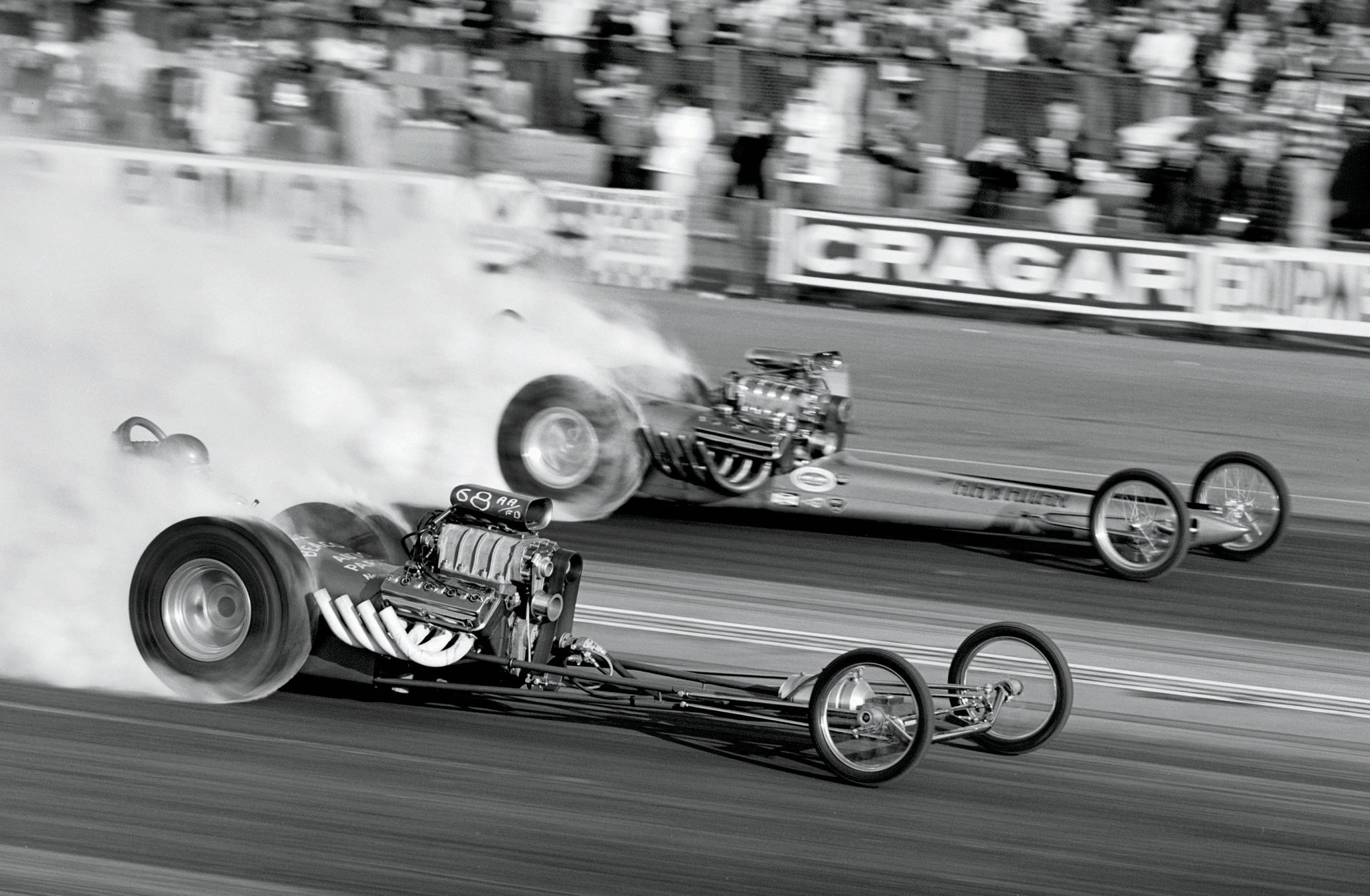 With 76 Top Fuel Dragsters contesting the fifth-annual Winternationals, nobody was picking these two kids to go far—let alone win NHRA's biggest two 1965 events. Rick Stewart (near lane) was the victim of Don Prudhomme's stout 7.75 in the Top Fuel semifinals, despite what appears to be airborne paper or cardboard clogging Don's injector hat. The Kent Fuller–built Hawaiian, a virtual duplicate of the all-conquering Greer, Black & Prudhomme fueler, went on to win September's NHRA Nationals (and would repeat the feat in '66, when Mike Snively respectively swept both meets for Roland Leong).