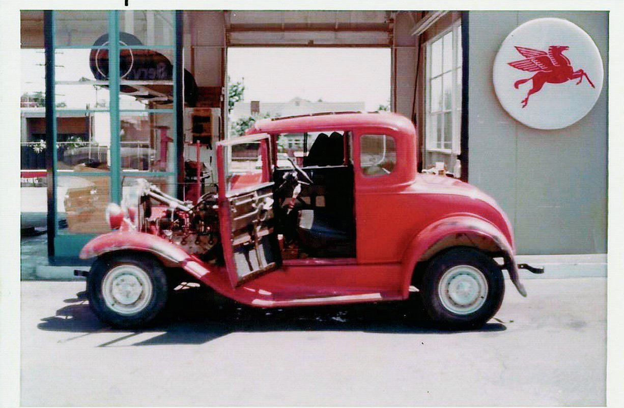 "Roger Jobe's flathead-powered '31 Ford five-window in front of the family's Mobil gas station in San Gabriel. They also had photos of the car racing at Irwindale. ""Ed said that his brother had sourced a 354 Chrysler Hemi, but had already installed the flathead to make the car run,"" Dale says. ""Then he got his draft notice, and the Hemi sat until it was sold off at later date, never to be installed."""