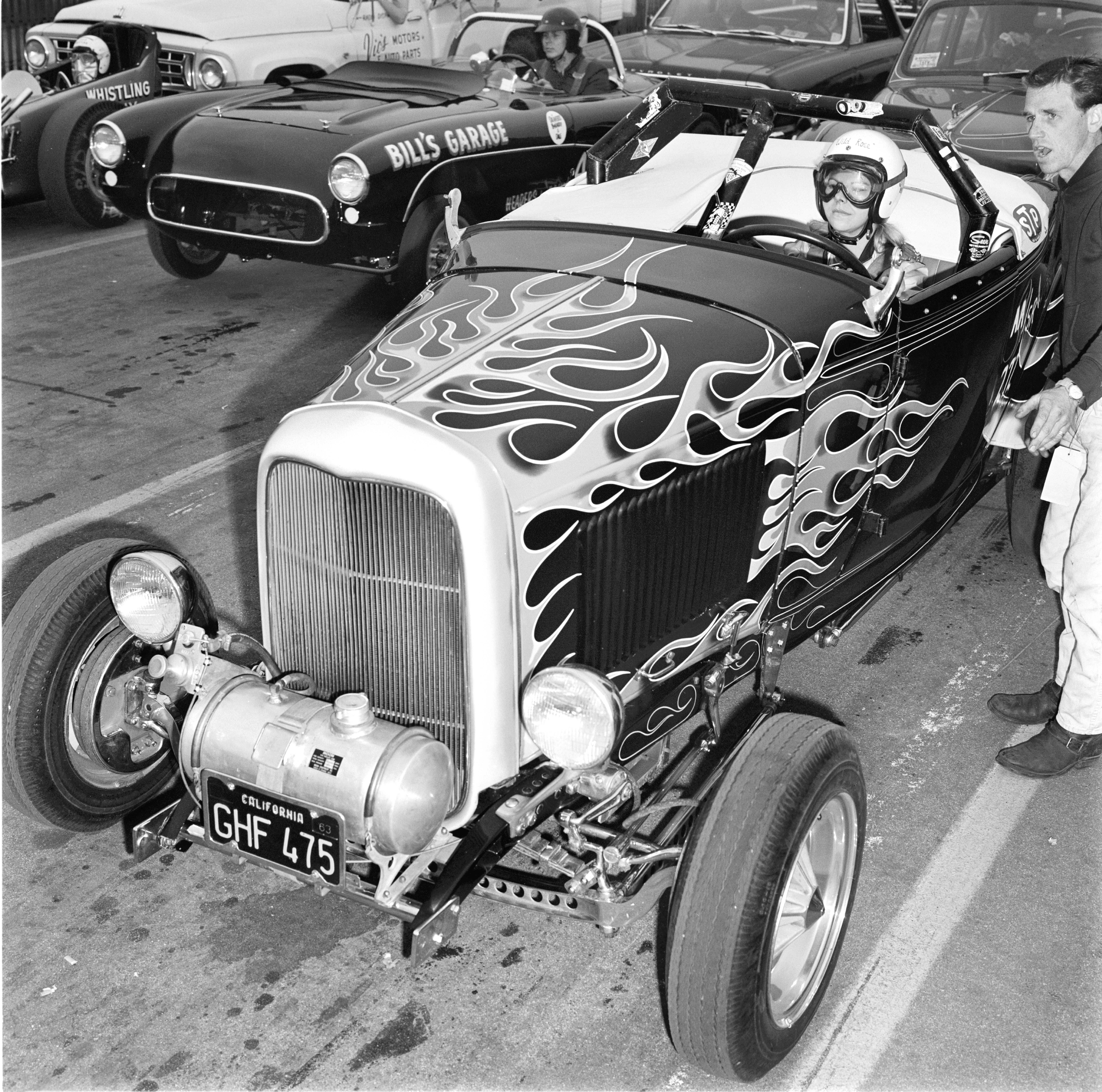 """Wild"" Rose Gennuso's 13.63/100.80 Pomona trophy dash clinched AA/Street Roadster glory in the Deuce of future husband Tom McMullen, also pictured. (Another female racer, Judy Lilly, topped B/Sport in a Corvette.)"