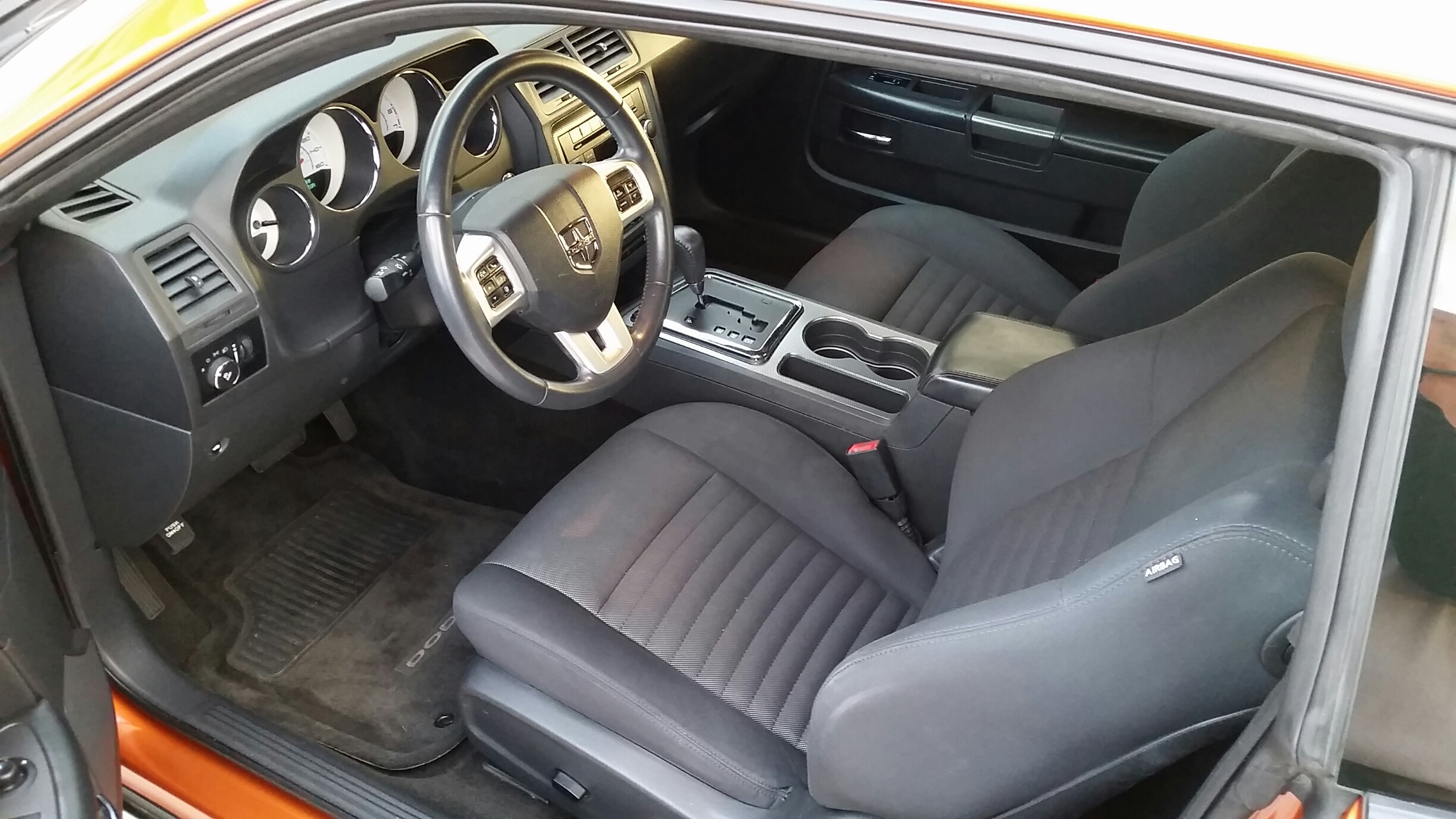 After being treated to Eagle One's Carpet & Upholstery Cleaner, and Interior Detailer, this 80,000-mile Dodge Challenger R/T interior is almost like new again.