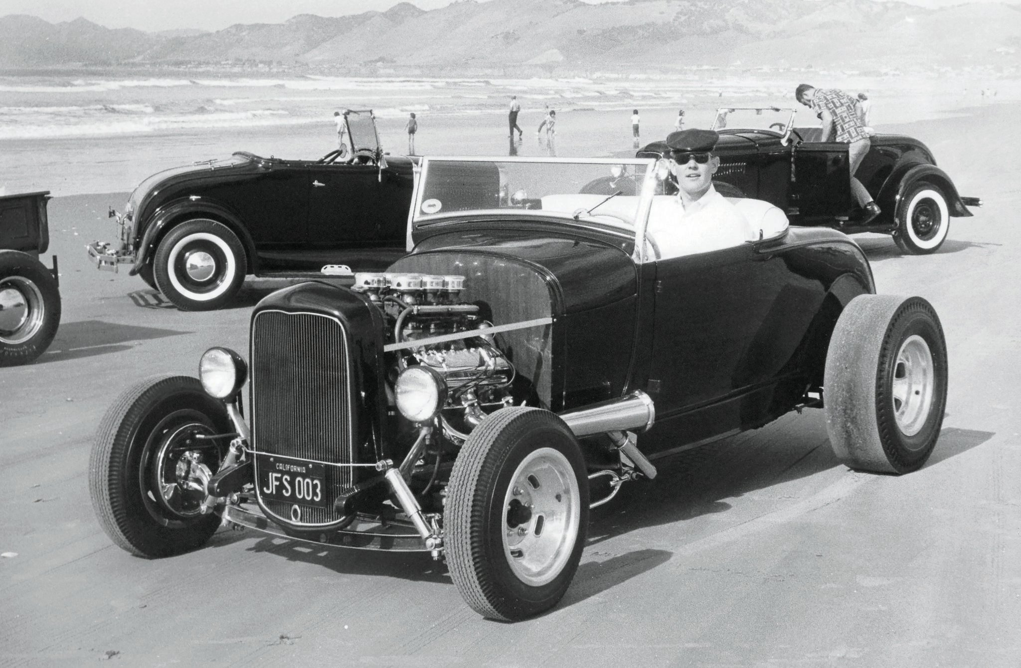 Sam Conrad and his Olds-powered '29 highboy with the L.A. Roadsters and Bay Area Roadsters, Pismo Beach, 1966.