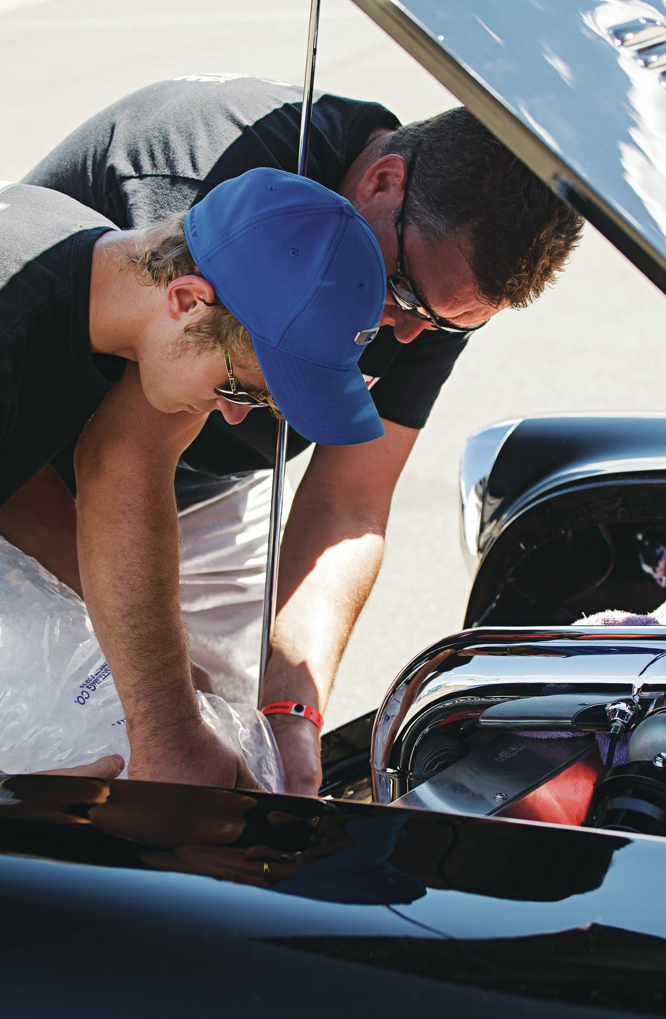 Like father, like son. Filling the air-to-ice water intercooler and bonding over fast cars.
