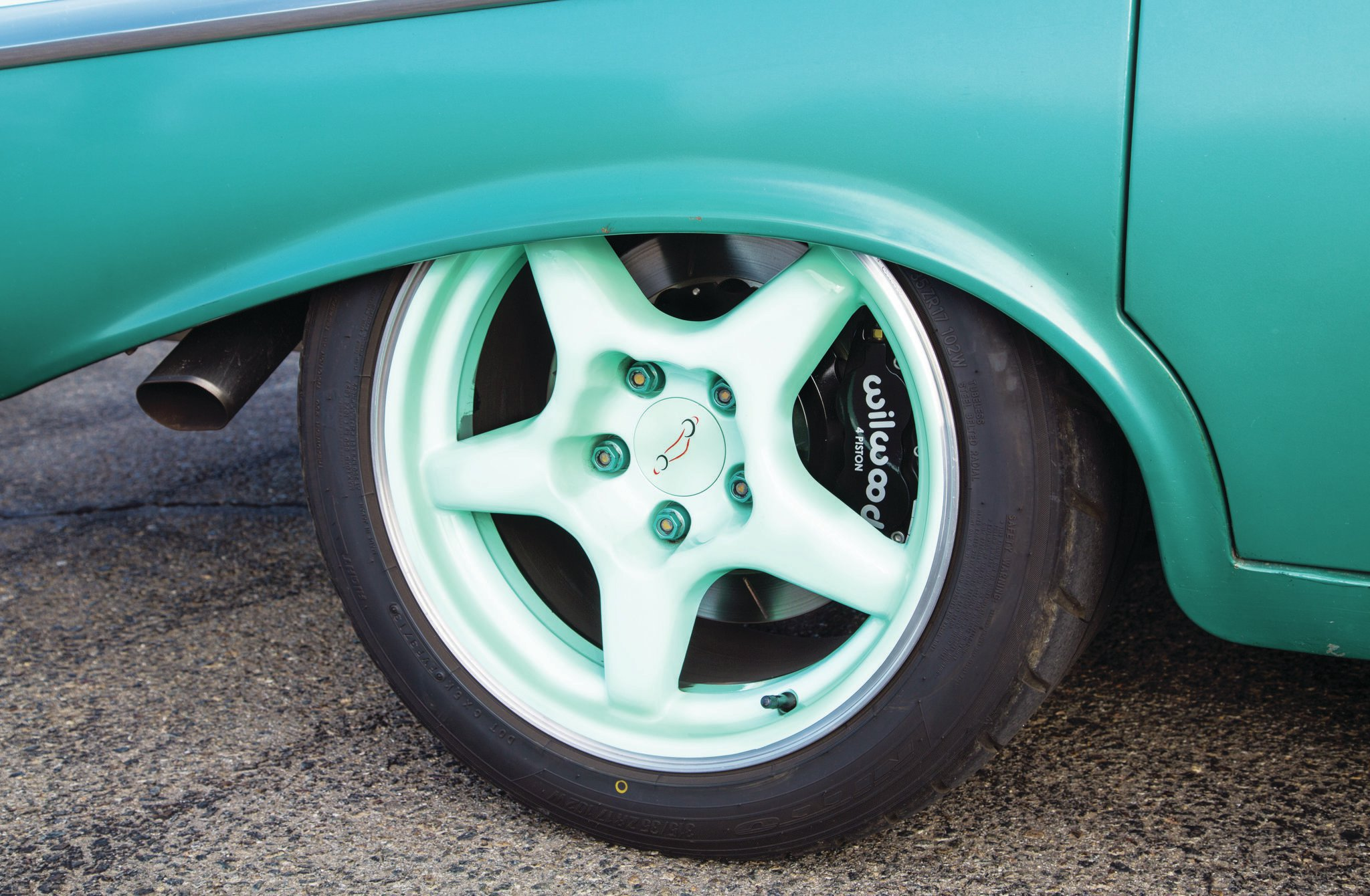 The Wilwood six-piston brakes peek through the 1996 ZR1 17x11-inch Surf Green painted wheels and Nitto 315/35R17 tires. Wheel-opening flanges have been flattened for added tire clearance.