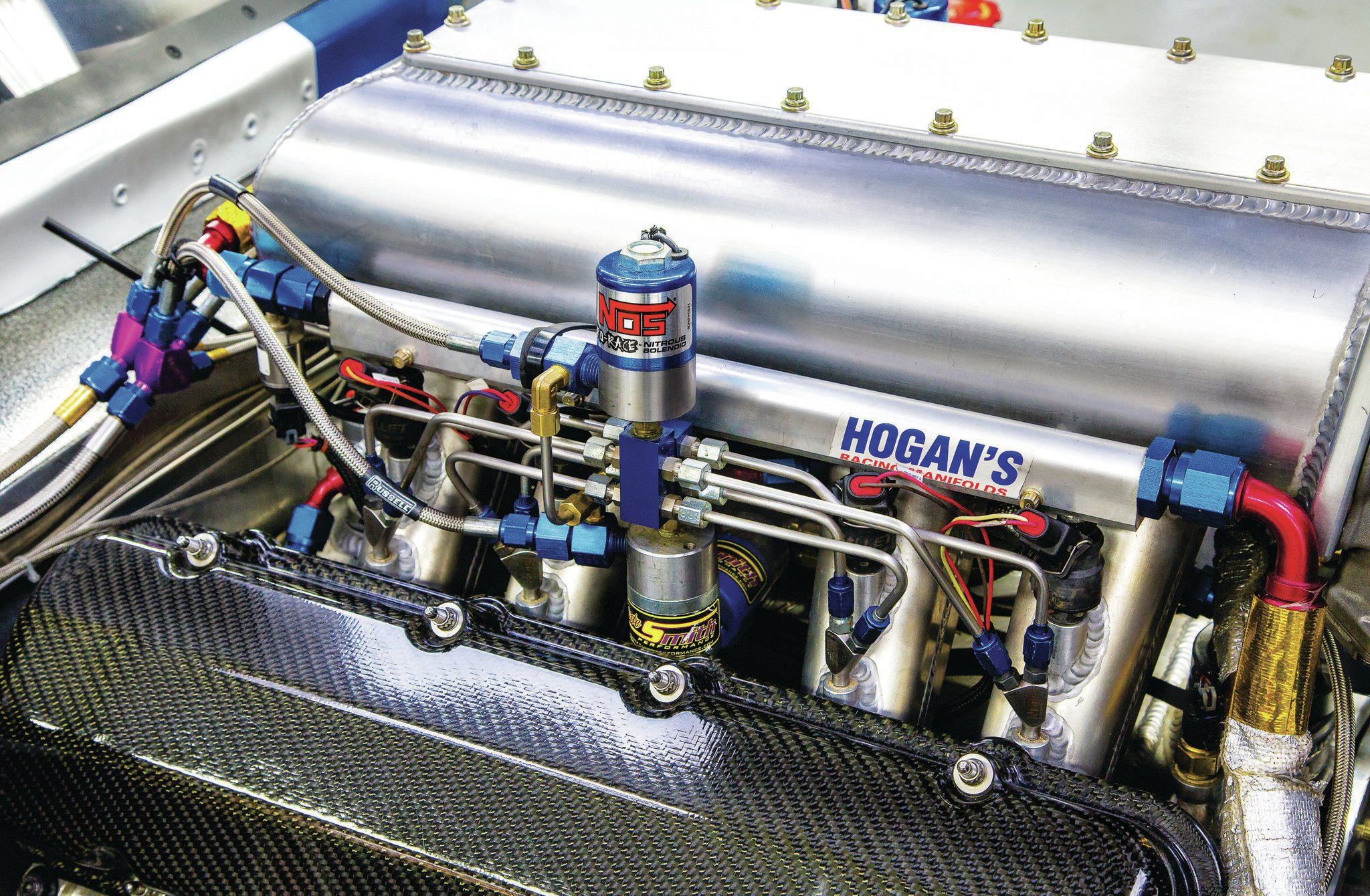 The Hogan intake has two GM Z06 drive-by-wire throttle-bodies and is plumbed for four stages of NOS Nitrous. It's all controlled by a Holley Dominator ECU that also kept Dave informed inside the car through a dash-mounted digital gauge package.