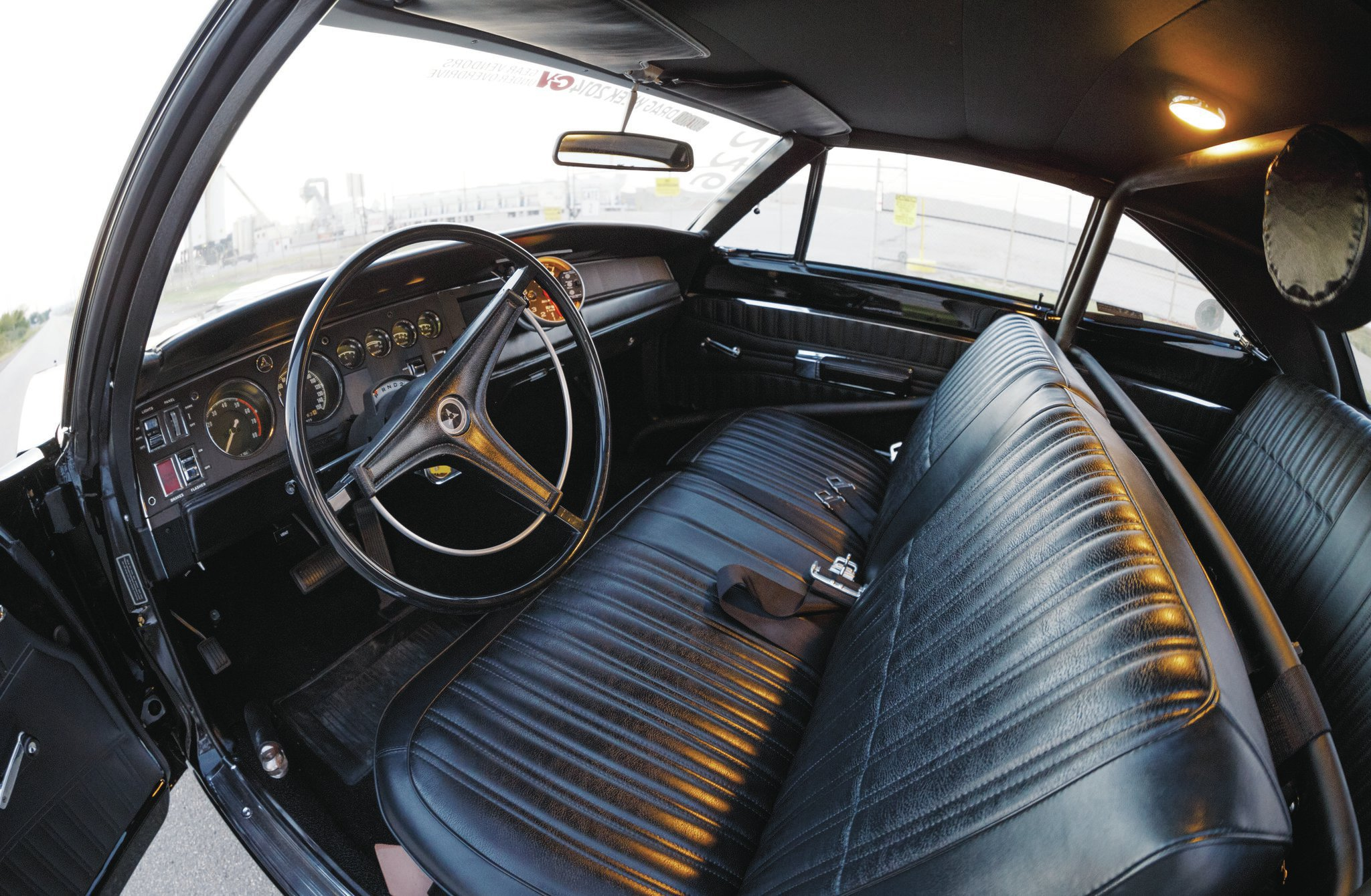 Bench seat, full gauges, stock steering wheel—you almost don't notice that rollbar.