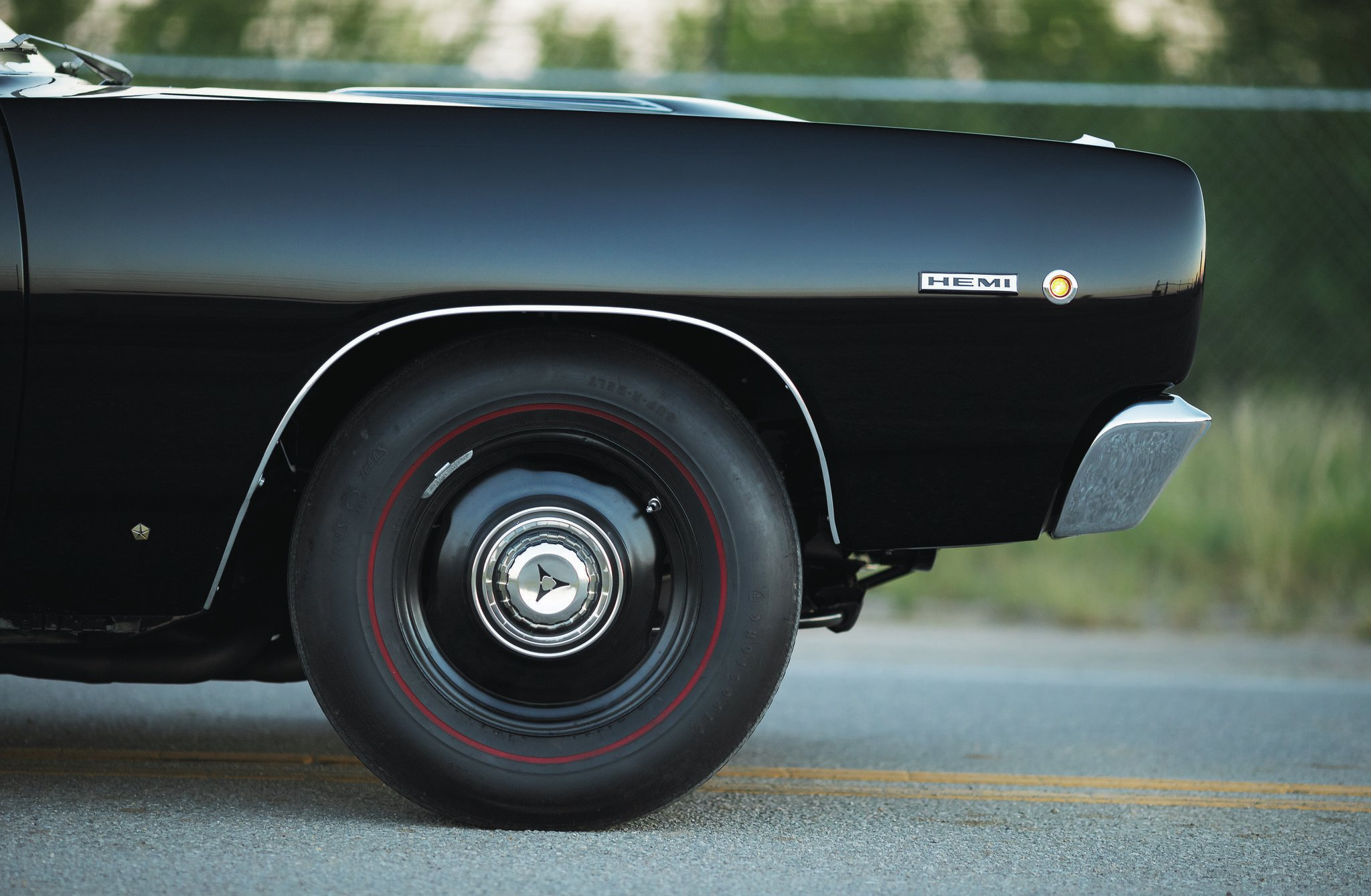 Those are 15-inch steelies wrapped in Coker repro bias-ply redline G70-15s all the way around. Watching this car run 10s on those tires is like watching a supermodel set a track-and-field record in stiletto heels. Astounding.