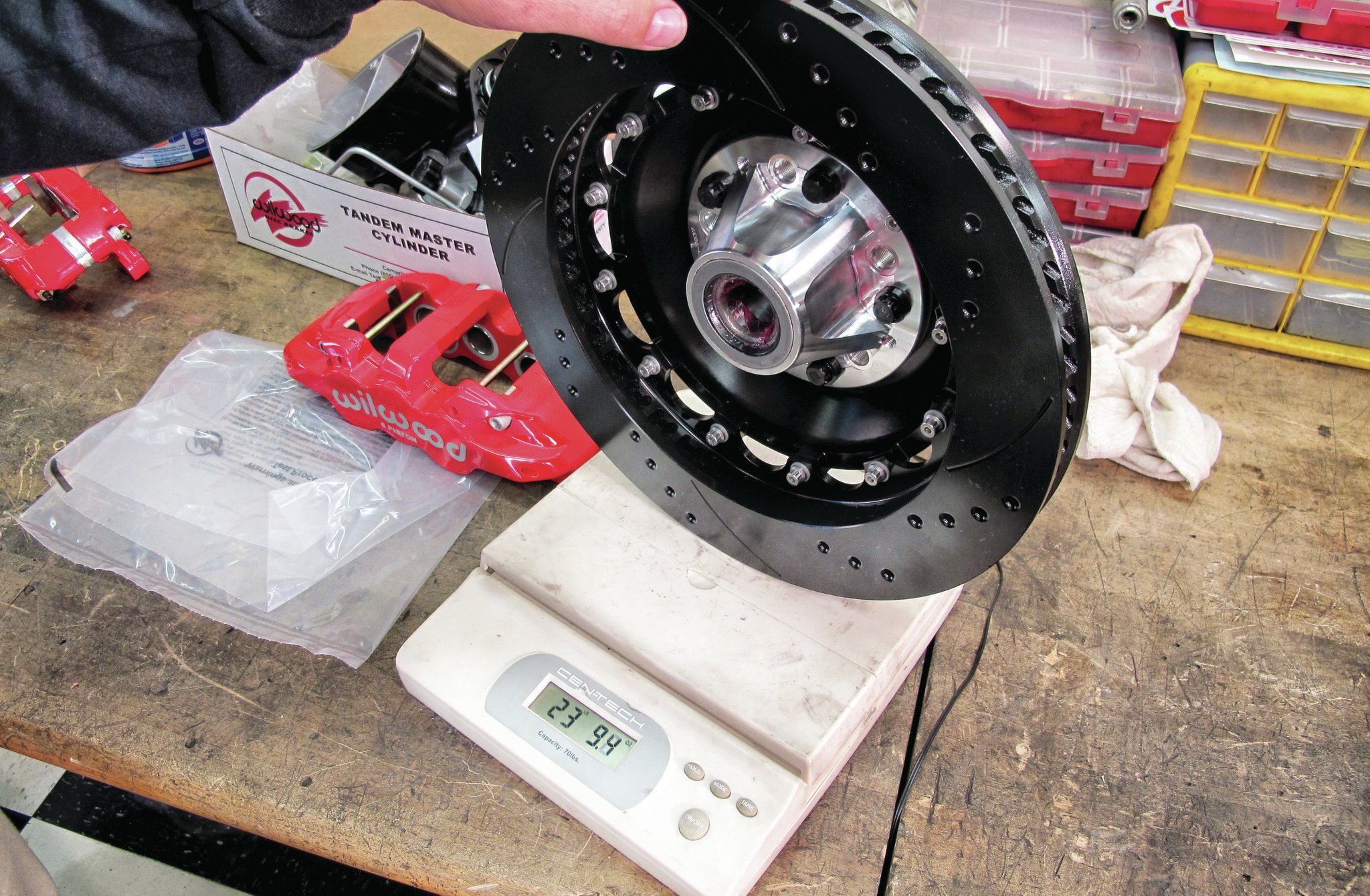 The 14-inch brakes weigh more than the old cast-iron parts, but they are a much larger part and work so much better that the penalty is worth the extra unsprung weight at each corner of the car. If you want to stop as hard as possible every time you hit the pedal, then go for the big brakes.