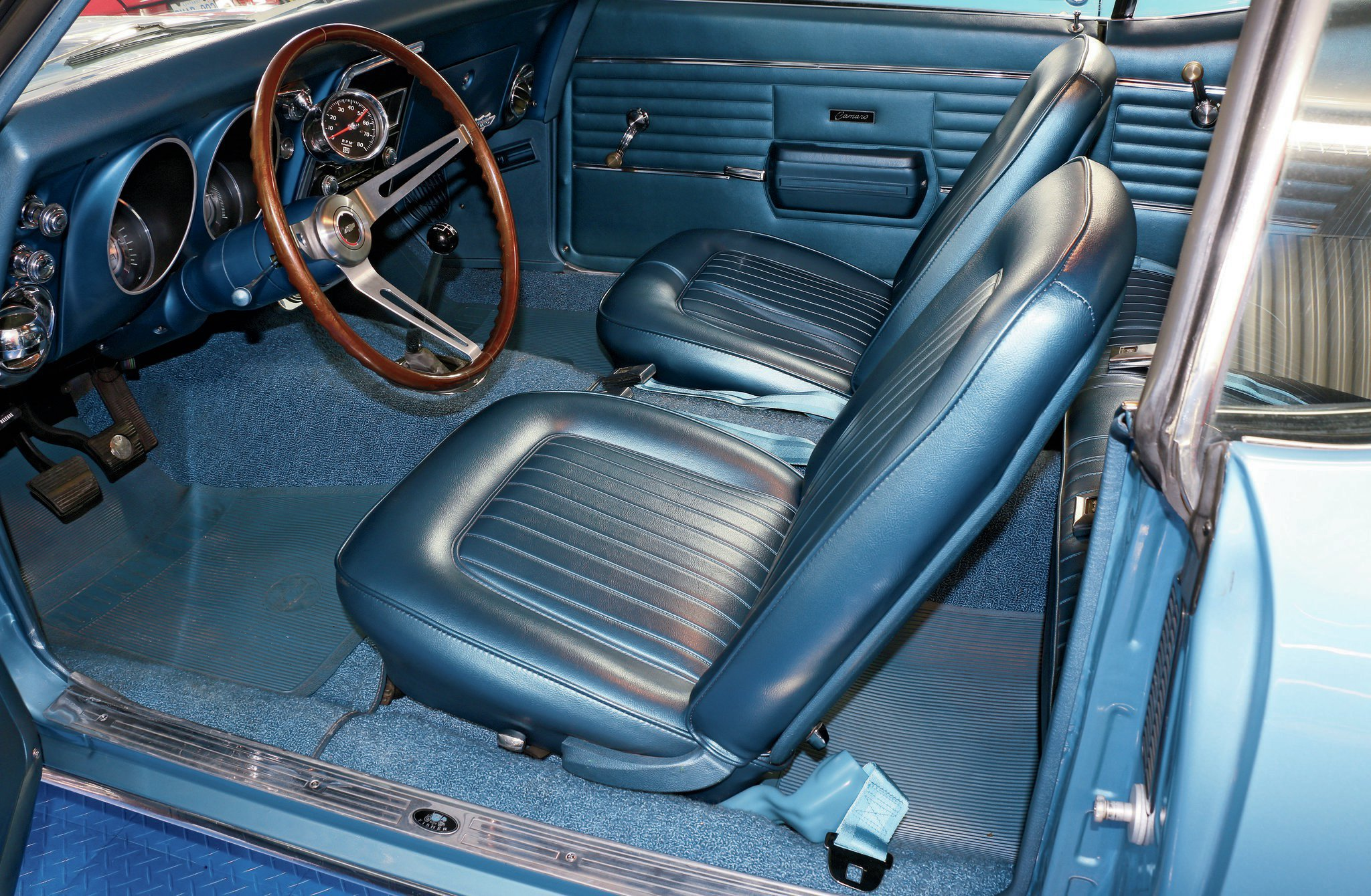 The factory blue interior is all business with the 140-mph speedometer, N34 Sport Styled Simulated Walnut Wheel, bucket seats, and no console.