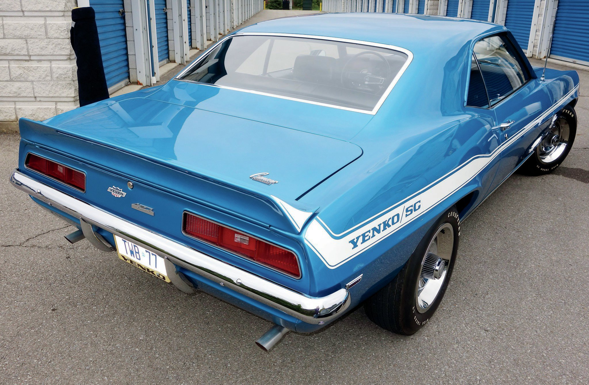 The Yenko/SC stripe ran down the side of the car, tying in nicely to the rear spoiler. All 1969 Yenko Super Camaros had both front and rear spoilers. The Yenko and 427 emblems were part of the Yenko conversion. For most of the 1969 cars, those emblems were located using the two holes from the factory Chevy bowtie emblem, explaining the staggered locations.