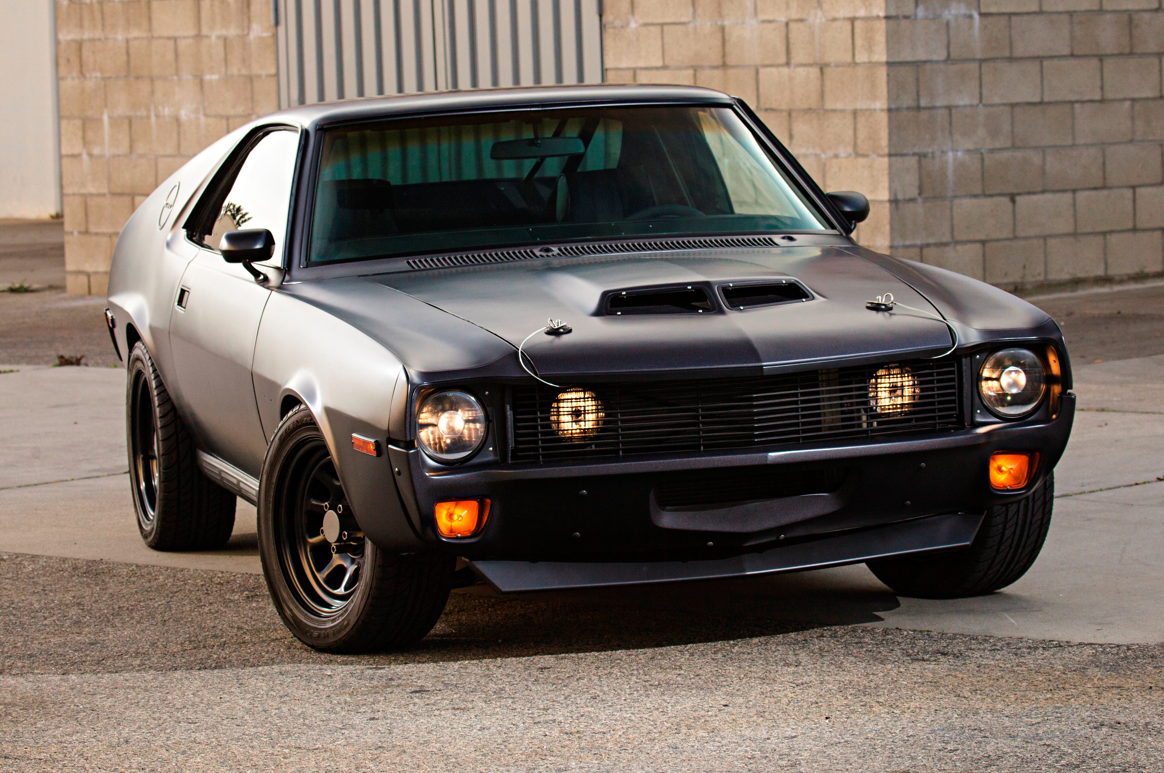 The '70 AMX may be his favorite year, but Allen never liked the flush-mounted grille. Instead, he made his own from aluminum and recessed it back a bit. Those projector lights were some cheapies he found at a speed shop, and the fogs behind the grille are tied in with the bright beams on the headlights.